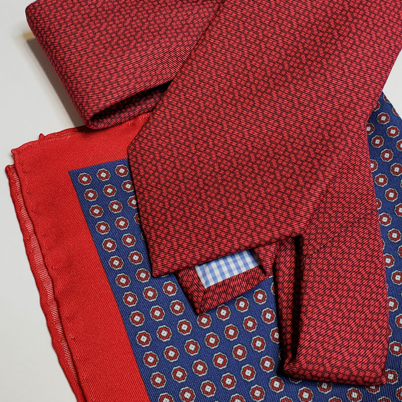 Italian Tie + Pocket Square - 2. Italian Tie and Pocket Square - available in a variety of colors, patterns and fabrics, choose one that you groomsman will know you thought of him when you saw it. And one less thing they will have to purchase themselves for their attire on your big day. Most of our pocket square inventory are one of a kind, see one you like? We can order more in time for your Big Day if you'd like your guys to match. Ties from $110, pocket squares from $45.