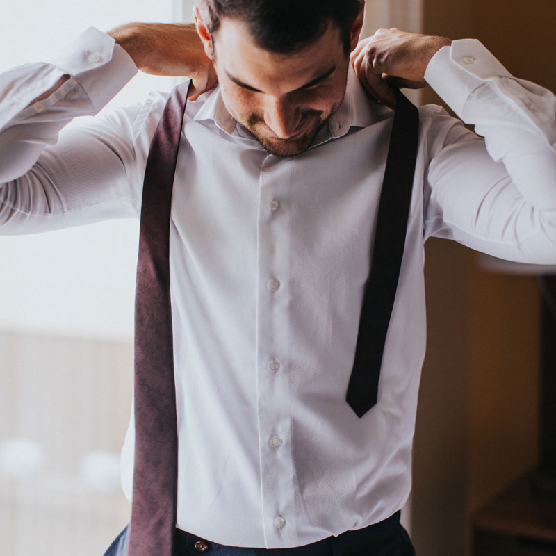 A Custom Shirt - Your Groomsmen need a white dress shirt to wear on your wedding day. Give them a custom clothing experience they will never forget - and know they'll look great on your Big Day, from $119.
