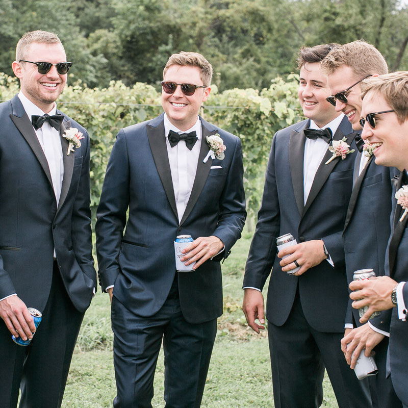 A Custom Suit, Jacket, or Tux - Invest in your friendship…and Wedding Day photos. Make the biggest impression and gift a custom clothing experience your Groomsmen or Best Man will never forget - and know they'll look great on your Big Day, from $625.