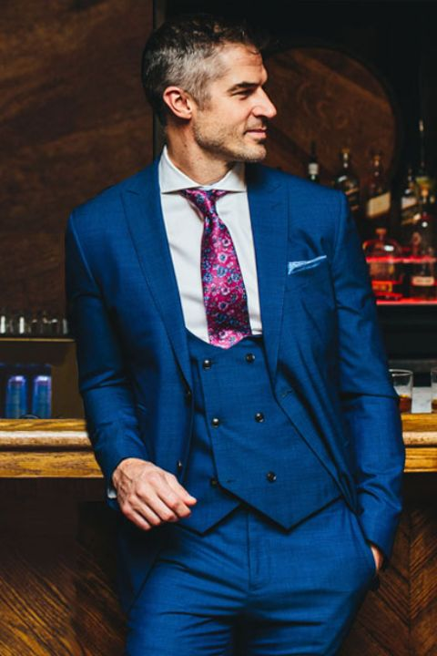 Cocktail Attire - Opt for a 2 piece or 3 piece suit in a darker color for evening events or a lighter color daytime weddings. Add some fun accessories to drop a little pop.TIP: A vest will keep you best dressed even when the jackets come off.