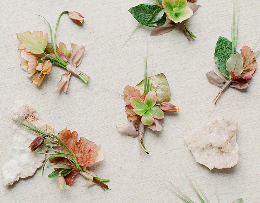 BOUTONNIERES IN SHADES OF RUST AND BLUSH, PLUCKED FROM THE BRIDE'S BOUQUET.   -