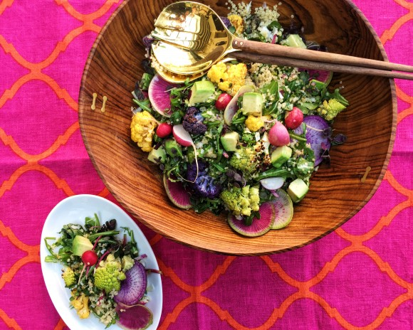 When spring produce starts flowing into our markets, I get really excited about making salads. There are so many veggies to play with, the options are endless. This salad is a combination of some of my favorite, really colorful market vegetables, paired with one of my favorite fillers, quinoa. The colors in this salad are so beautiful together, they make me think of spring. The combination of roasted cauliflower, crunchy radishes, creamy avocado, nutty quinoa, peppery arugula and bright, lemony vinaigrette make this salad a delicious side dish for pan seared chicken or roasted salmon, or as main course on a warm spring day. If you love cheese, feel free to add some grated Pecorino Romano or crumbled feta to the quinoa for added flavor.  If you love the  Sanet rosewood bowl  that this salad is being served in or the  Nicola brass salad serving pieces , you can buy them from Alfred through the links, or at Alfred's shop at 218 Columbus Ave in San Francisco.  Total Time: 45 minutes Serves 8 to 10 as a side dish  Ingredients   Quinoa   1 cup uncooked white or golden quinoa 1½cups water ½ teaspoon salt   Salad Vegetables & Greens   1 small head yellow cauliflower, cut into small florets * 1 small head purple cauliflower, cut into small florets * 1 small head romanesco or 1 small head broccoli, cut into small florets ¼ to ½ cup neutral flavored oil like  Thrive® oil  or avocado oil for roasting vegetables ½ teaspoon kosher salt 1 teaspoon salt ½ teaspoon pepper 1 bunch Easter egg radishes, greens trimmed, cut into halves or quarters 1 small purple daikon radish, thinly sliced into rounds with a knife or mandoline (optional) 1 watermelon radish, thinly sliced into rounds with a knife or mandoline (optional) 4 handfuls baby arugula leaves 1 large ripe avocado, diced just before serving  *If you can't find different colored cauliflower just buy 1 large head white cauliflower.   Lemon Vinaigrette   ½ cup champagne or white wine vinegar 2 teaspoons packed lemon zest ¼ cup fres