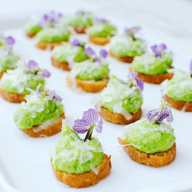 We've been catering a lot of baby showers lately and this is one of my favorite hors d'oeuvres from recent menus: English pea and fava bean crostini with pecorino and wild arugula flowers. It's spring in one little bite 🌷 #thecitykitchensf #mymarinkitchen • • • • • #spring #horsdoeuvres #crostini #peas #favabeans #pecorino #edible #flowers #local #smallbites #entertaining #feedfeed #f52grams #goopmake #tastingtable #buzzfeast #yum #foodpic #foodporn #beautifulcuisines #huffposttaste #instayum #foodandwine #bghfood #thekitchn #f52farmstand #instafood #foodphotography