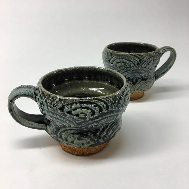 A couple new mugs fresh out of the gas kiln. These little beauties have a green celadon liner and blue ash glaze on the outside. #mugshotmonday #crunchy #pottery #ceramics #ashglaze #functional #stoneware
