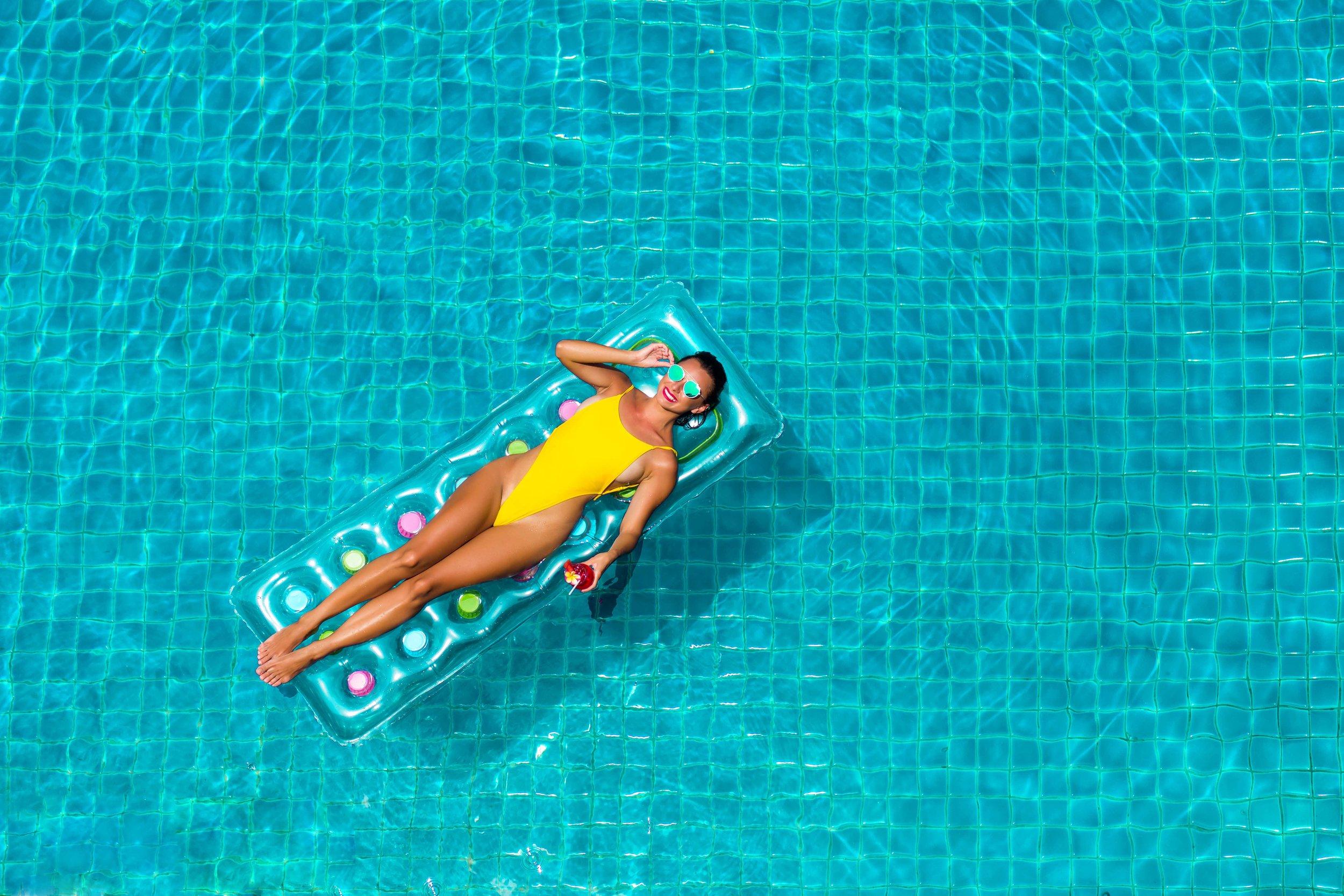 Woman louning in Key West pool.jpg
