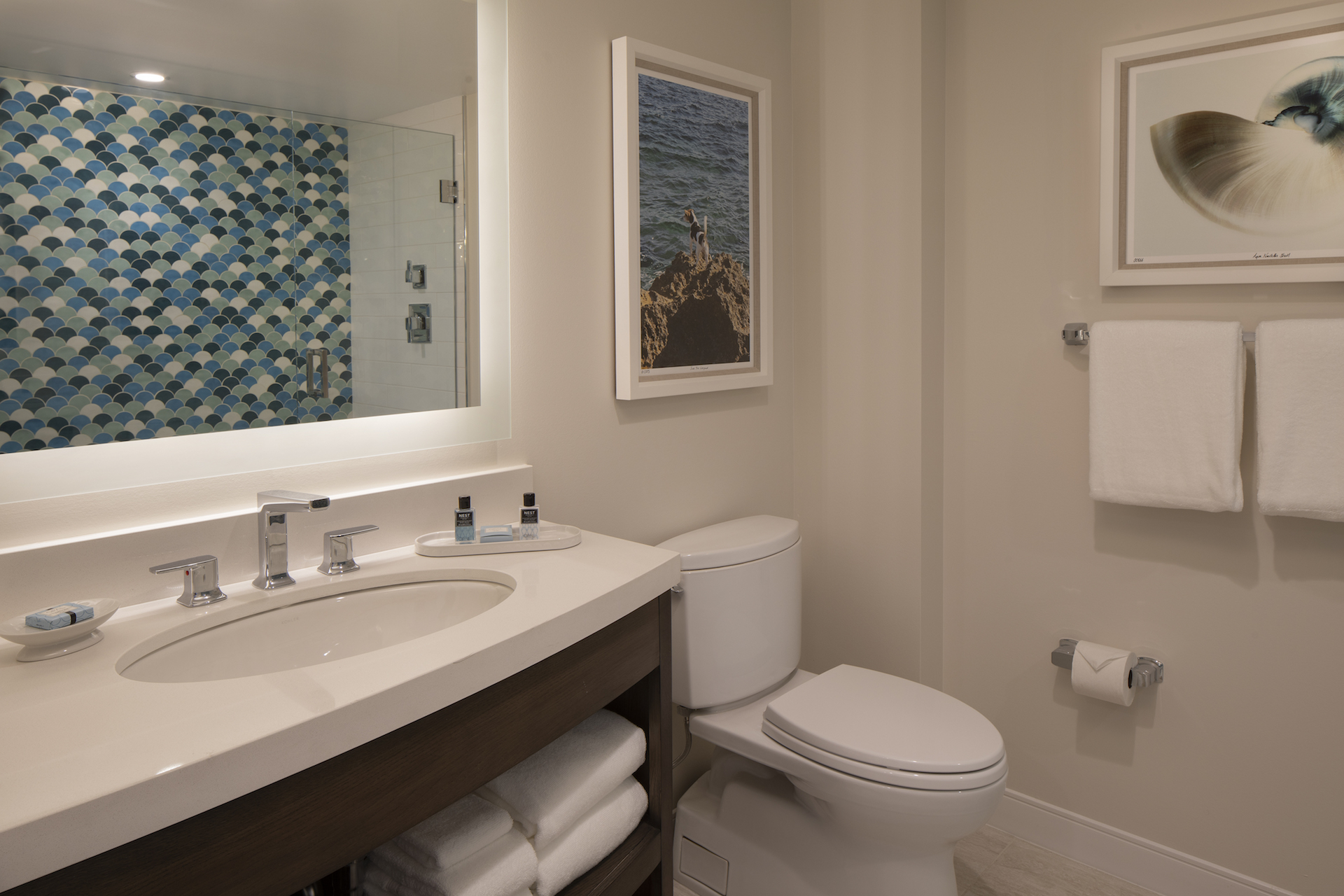 The Laureate Key West guest room bathroom sink and toilet