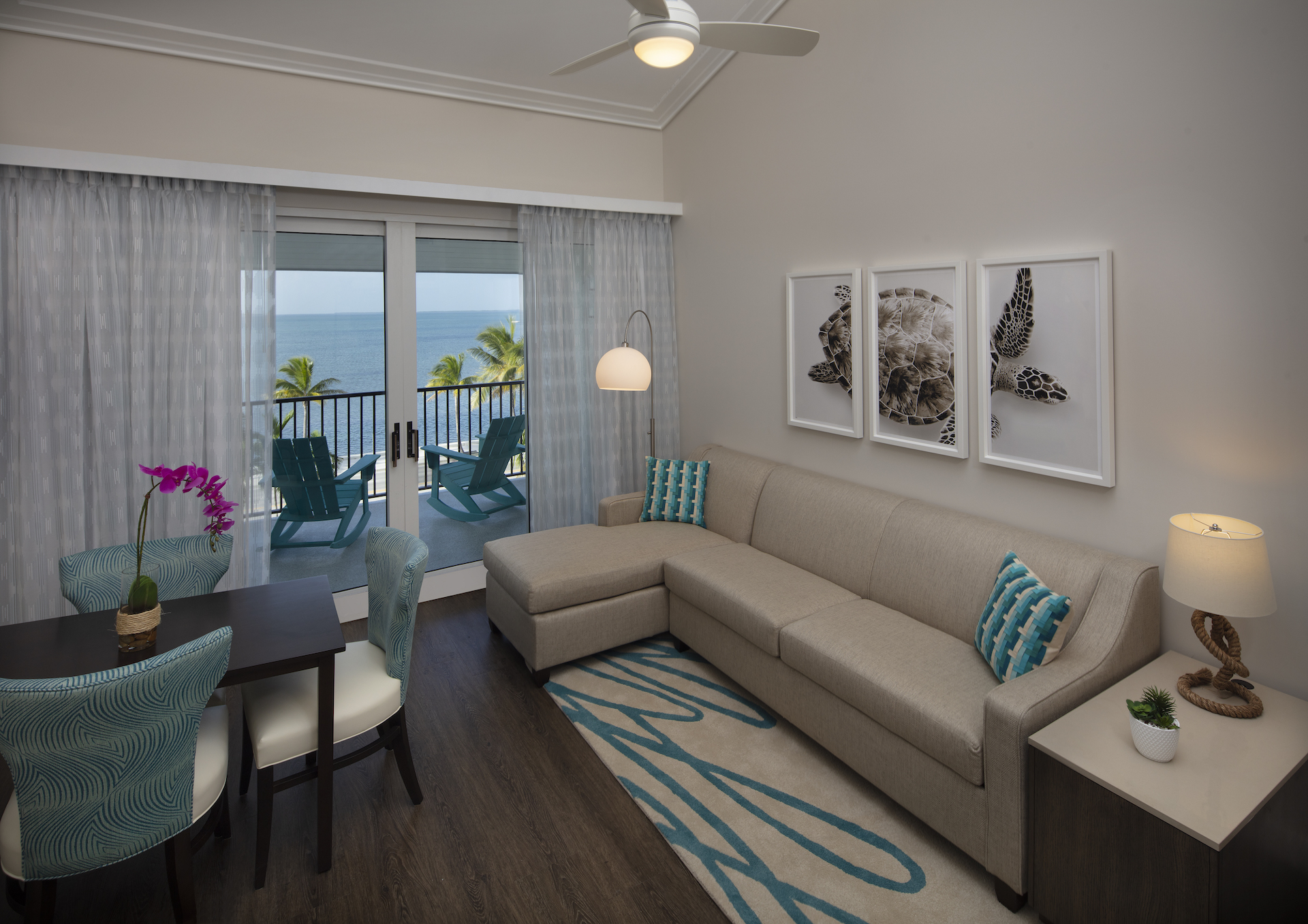 The Laureate Key West living room, dining area, and balcony