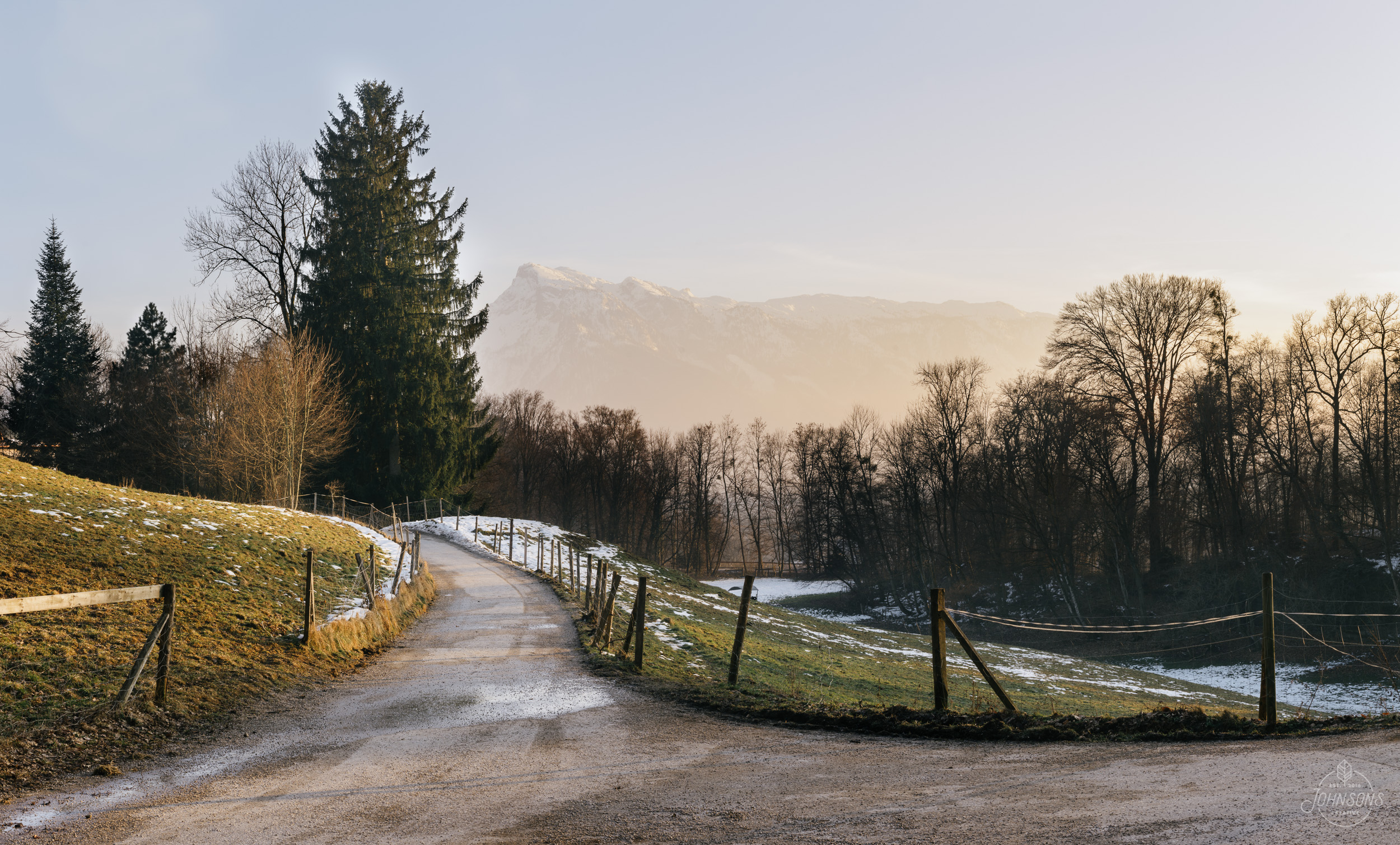 Sony a7rii  55mm 1.8  f14  1/13 sec  ISO 50  5 image stitched panorama    This location is about a 10 minute walk West of the Museum Der Moderne Salzburg. I am a bit bummed because the composition is so great but the trees look sad and the melted snow isn't my favorite, so it's on my list of spots to return to in the fall or snowy times.