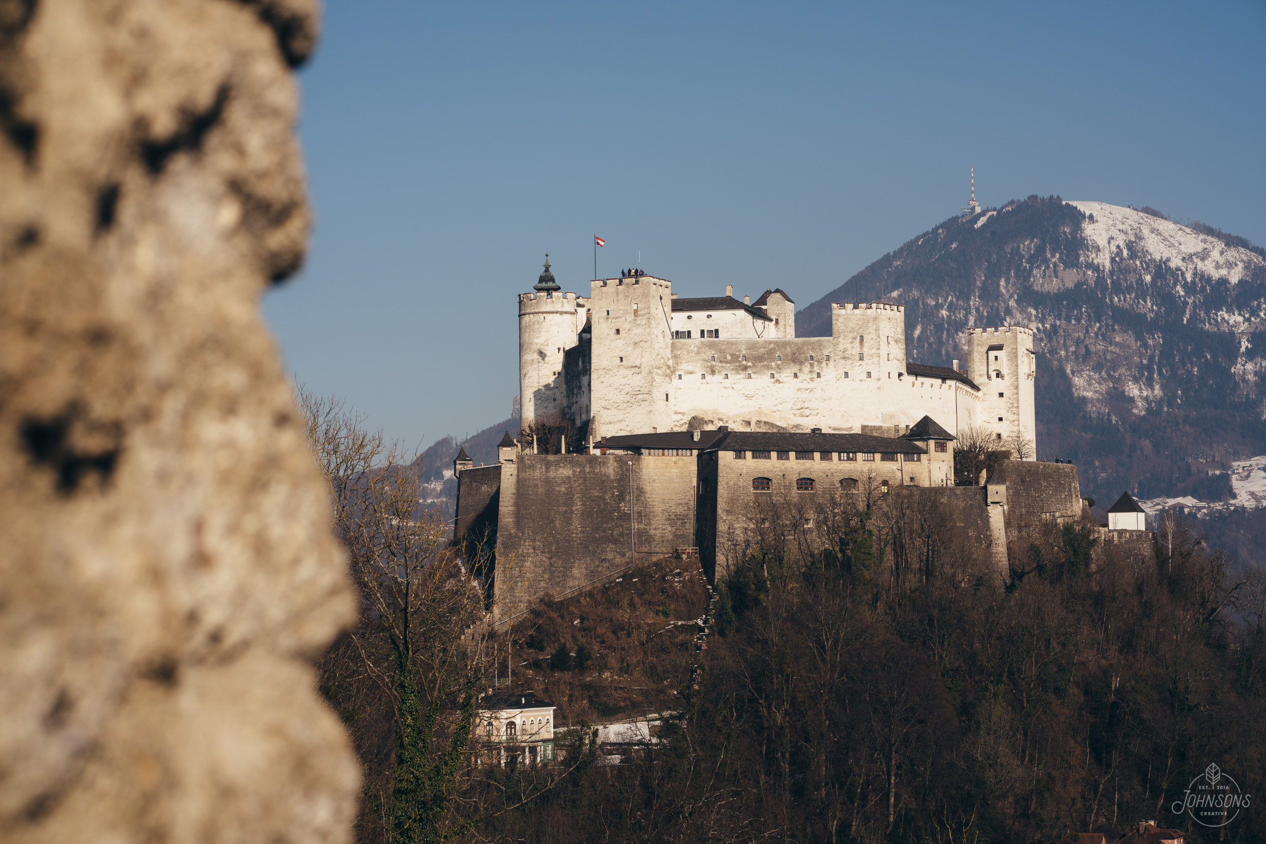 Sony a7rii  85mm 1.8  f10  1/320  ISO 100    This is Hohensalzburg Castle, which is touristy inside but is pretty neat (although overpriced). Photo wise I couldn't find any great compositions, but google images tells me that they are out there...    This was from a lookout spot that seemed pretty popular between the Fortress and the museum.