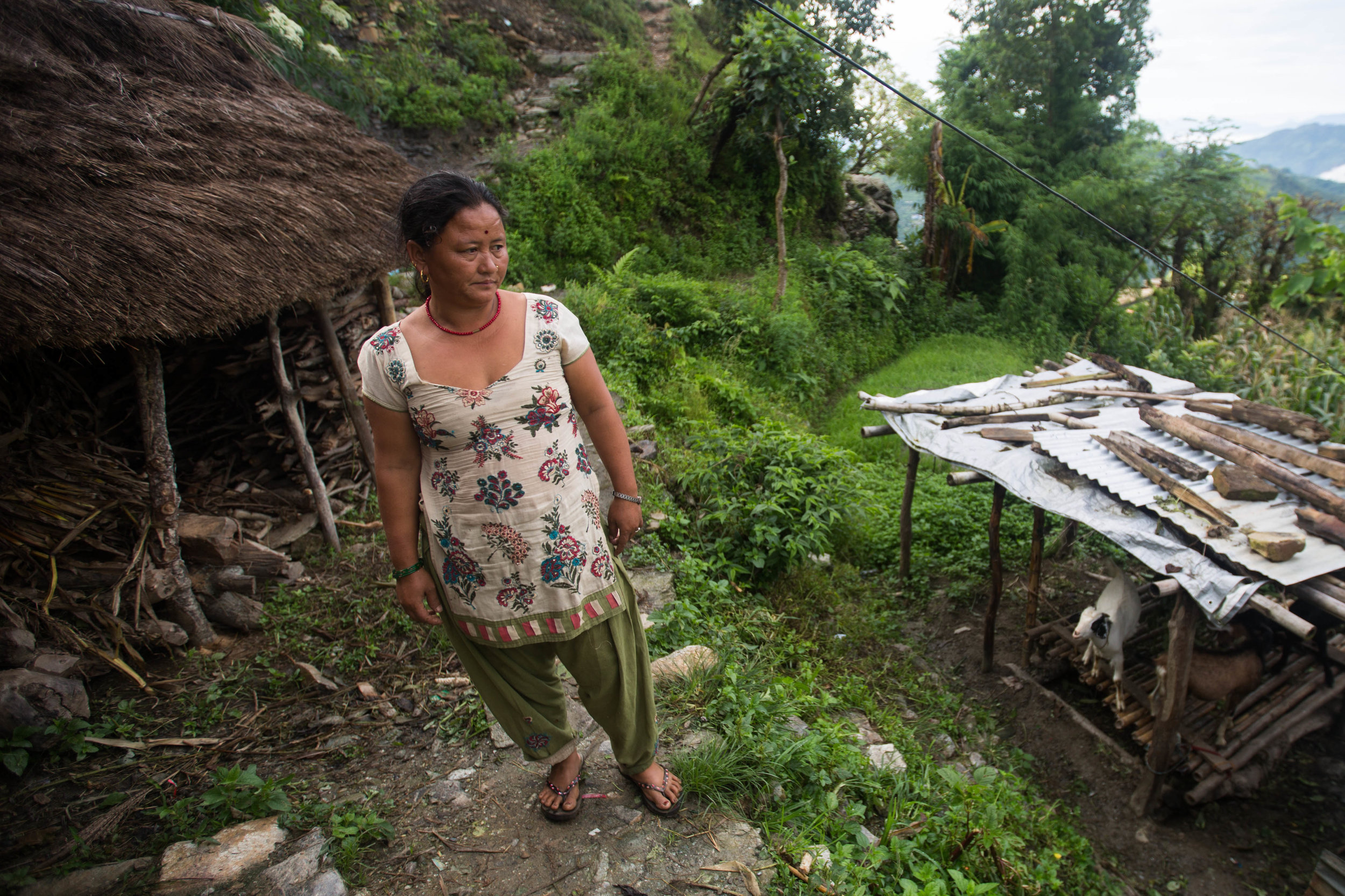 Chari Baram stands outside her home in Gorkha, Nepal, on Aug. 1, 2016.
