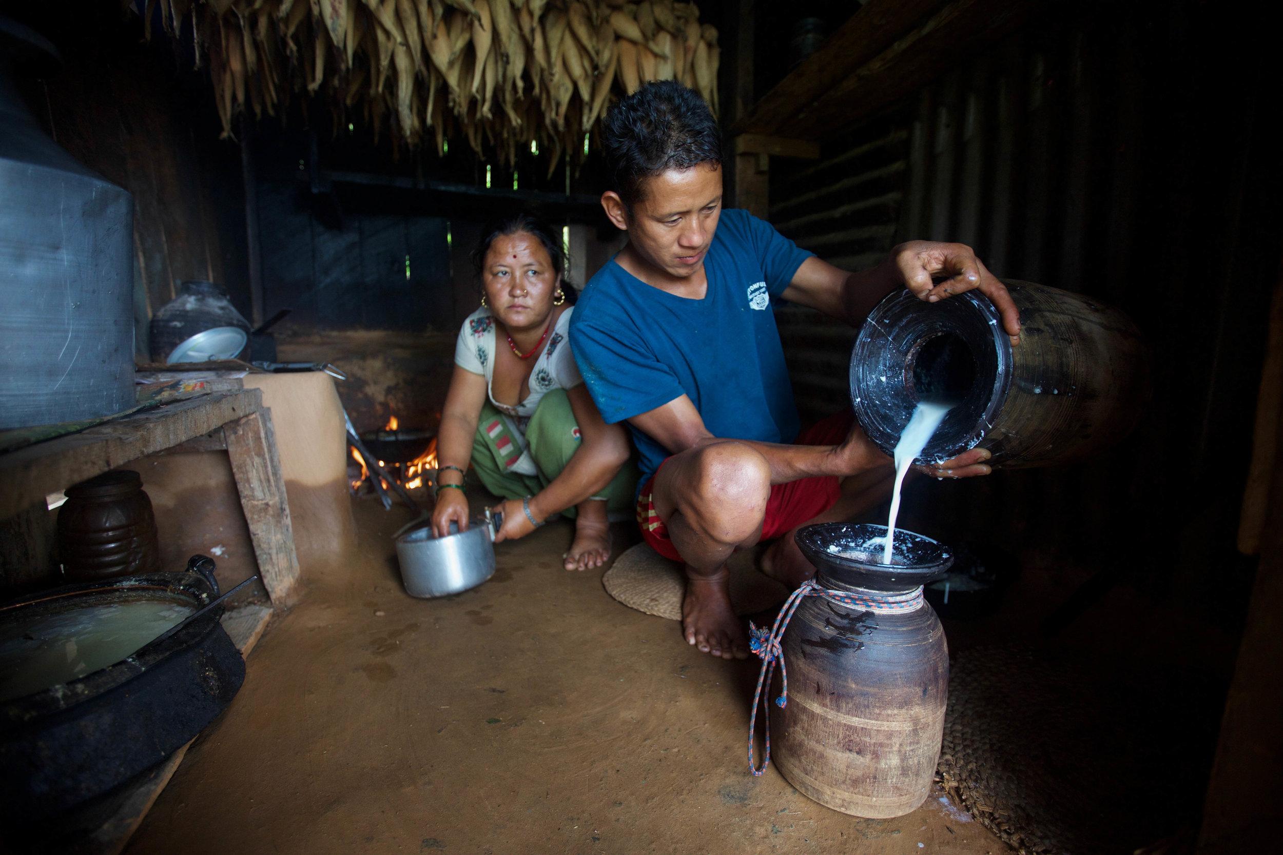 Chari, 32, and her husband, Bhoj, 32, prepare food on Aug. 1, 2016.