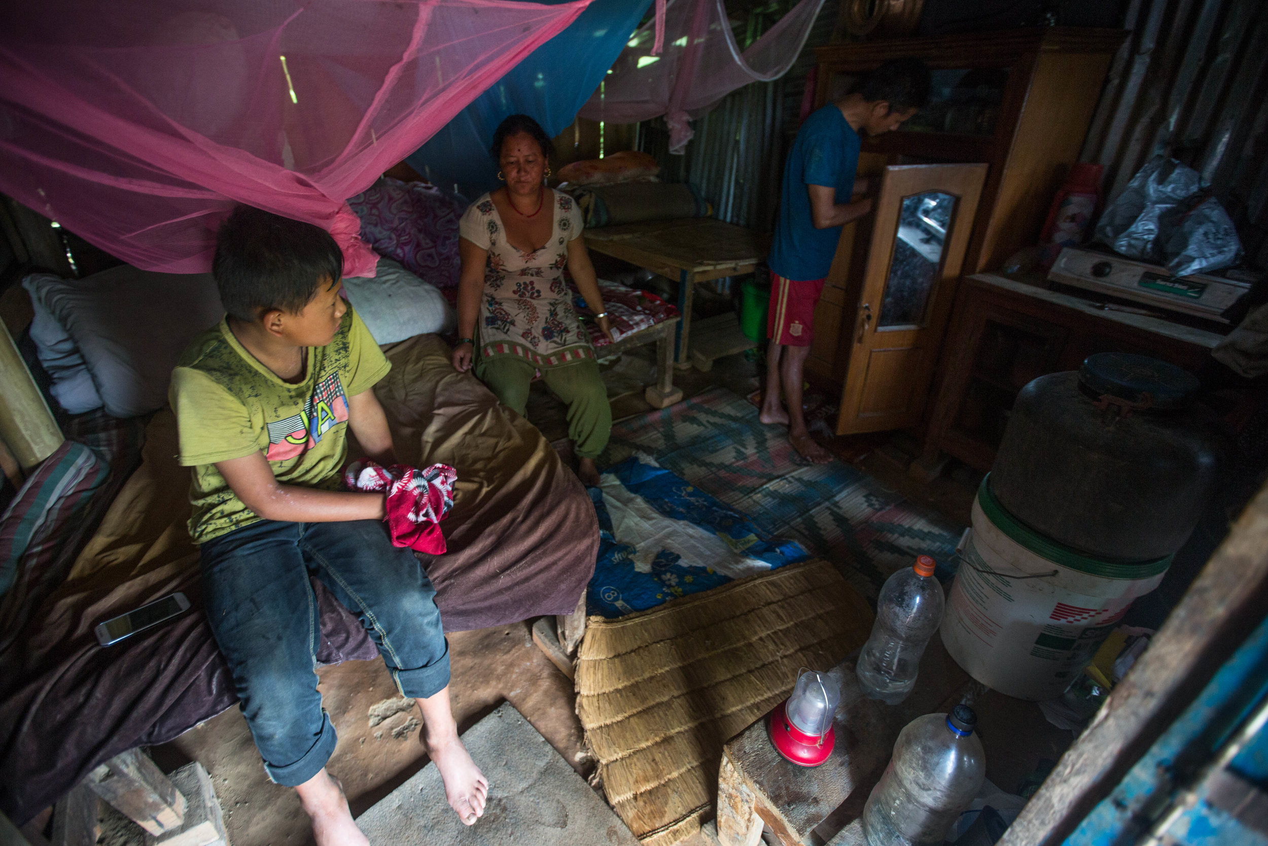 Sunil, Chari and Bhoj in their temporary home in Gorkha Nepal. Living near the earthquake's epicenter, they lost their home in 2015; they still await government assistance.