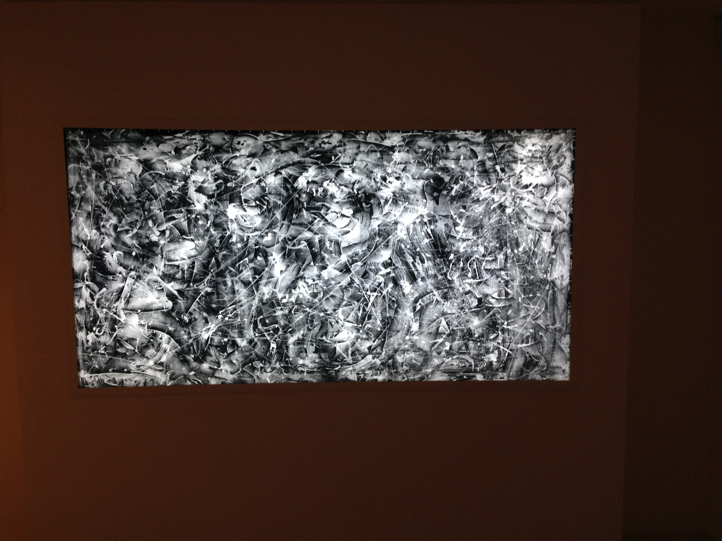 A Jackson Pollock piece on display.