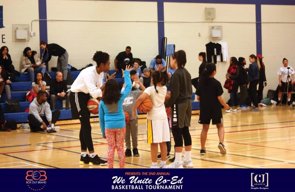 Teaching young girls and boys at the GDIB Box Out Brand Co-Ed basketball tournament.