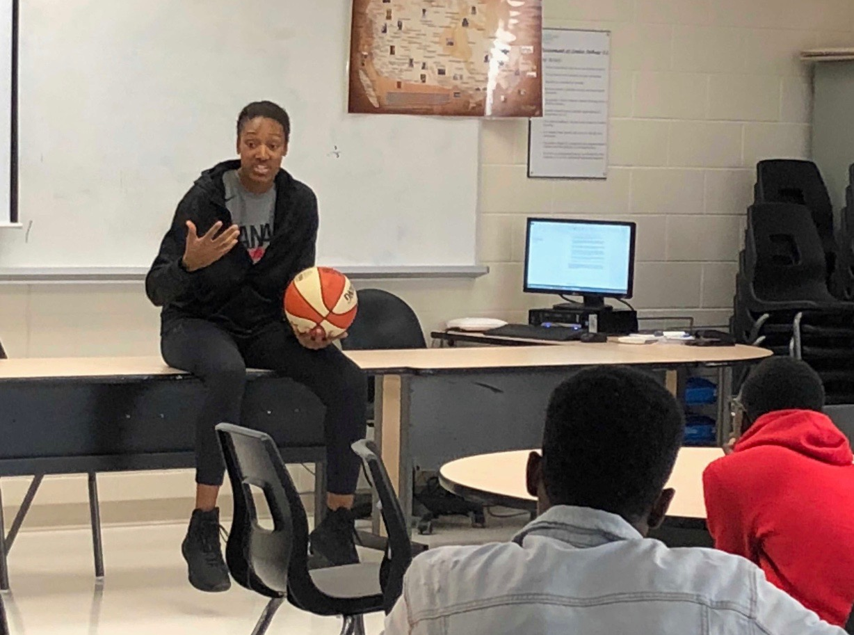 Speaking to High School boys at Louise Arbor Secondary School about the importance of academics.