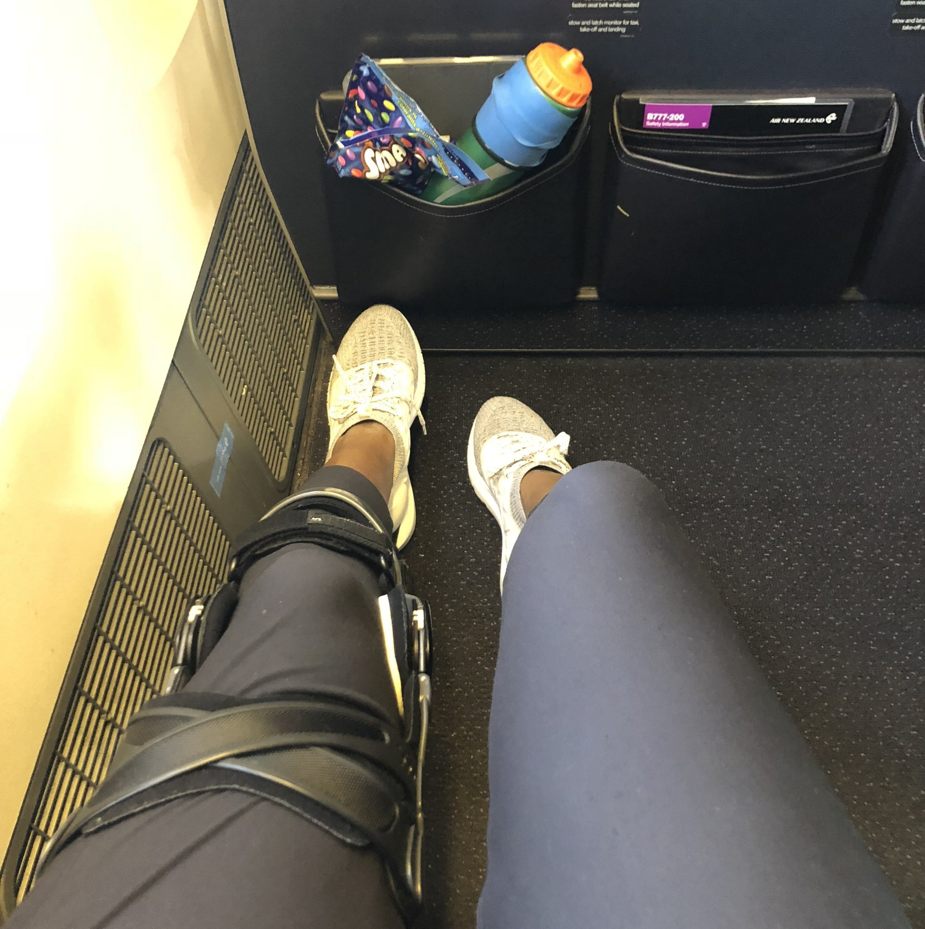 Brace life on the plane. Also packing my essentials, water and smarties!