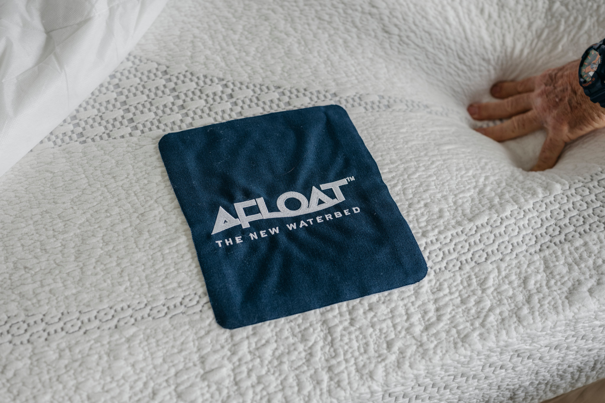 Afloat's logo on a bed in Mr. Hall's home.  Credit  Ian C. Bates for The New York Times