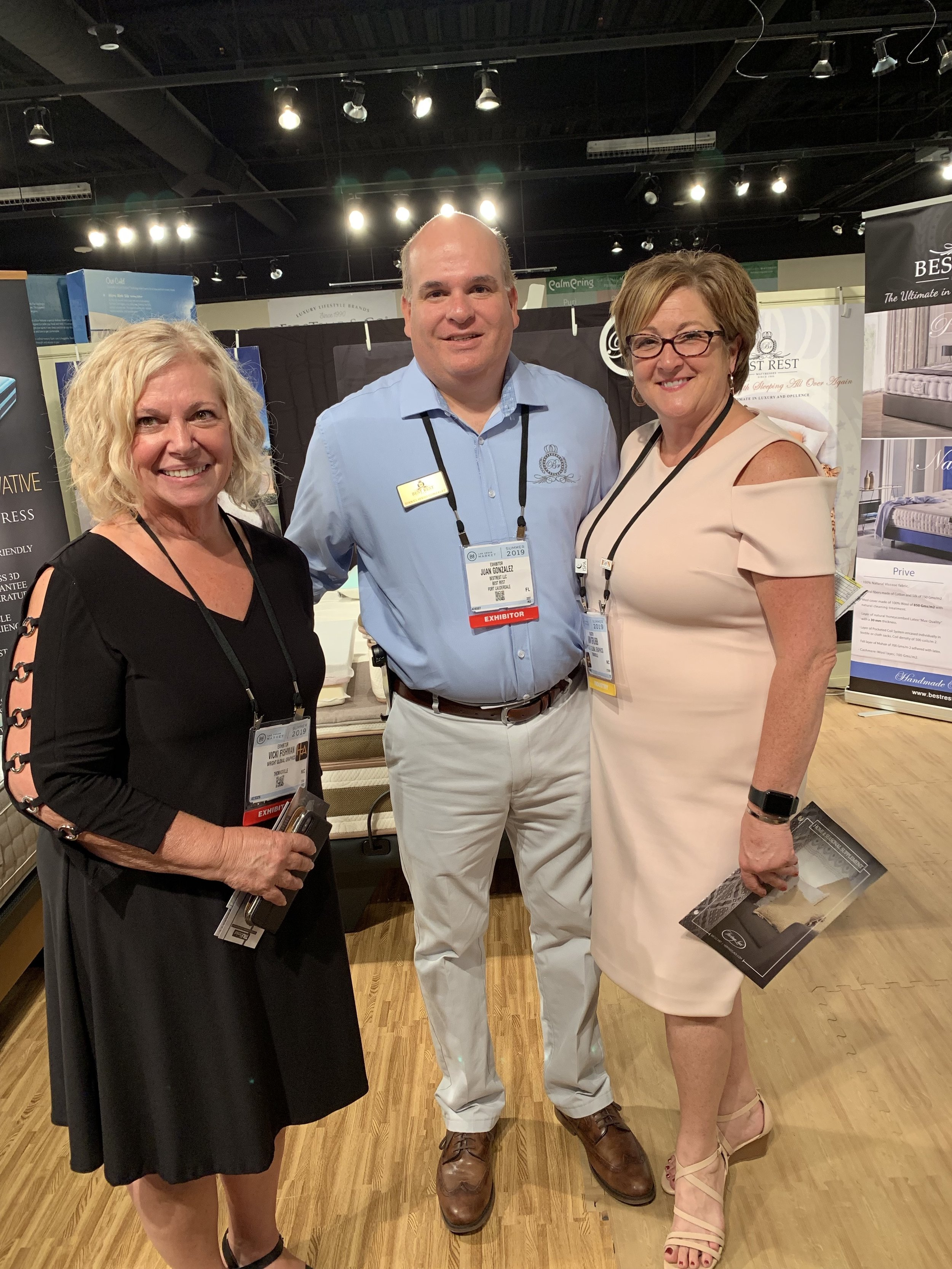 Juan Gonzales chats with the ladies from Wright Global Graphis