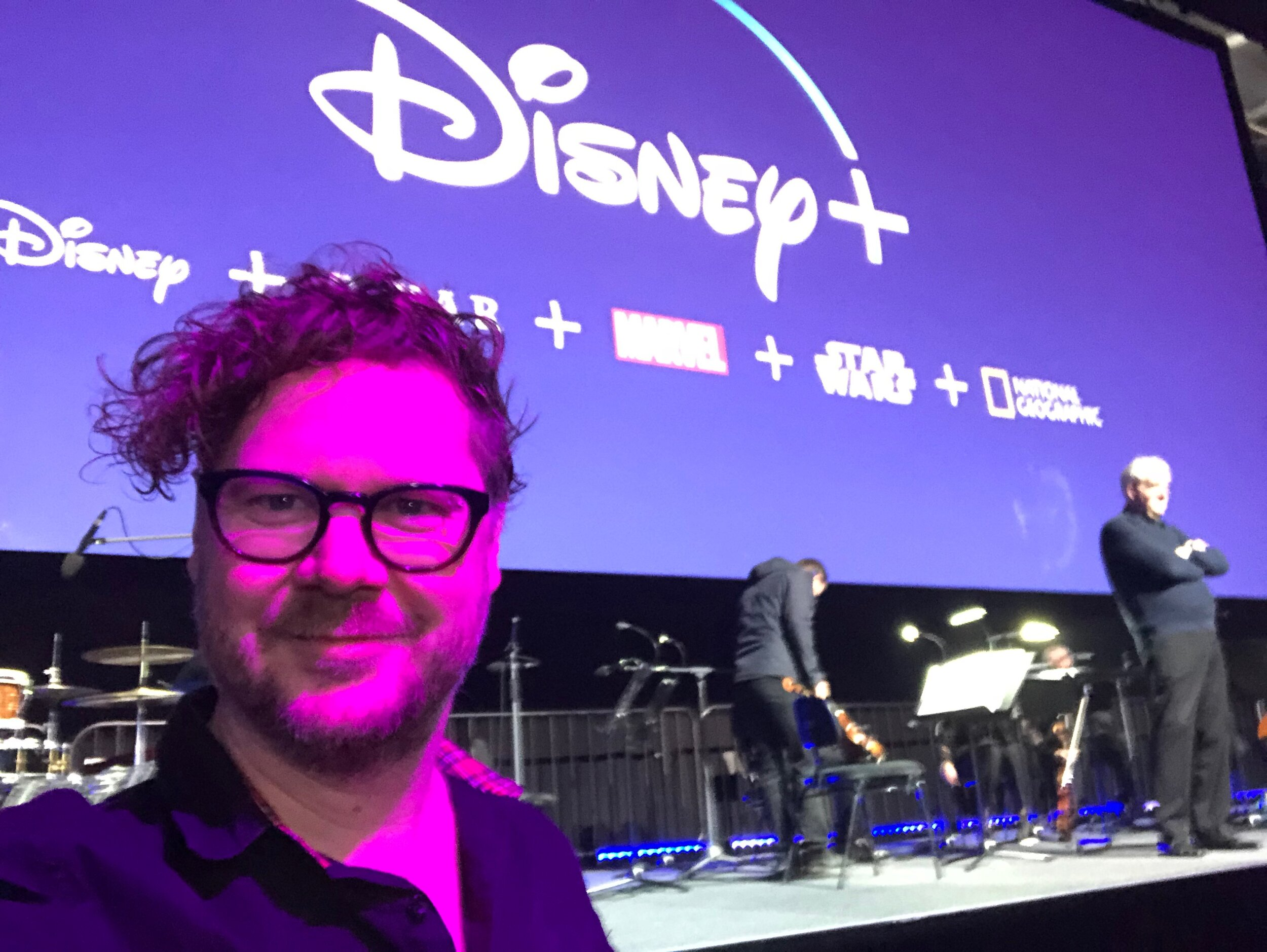 Jamie Messenger preparing to play keyboards with the MSO at Marvel Stadium for Disney Showcase