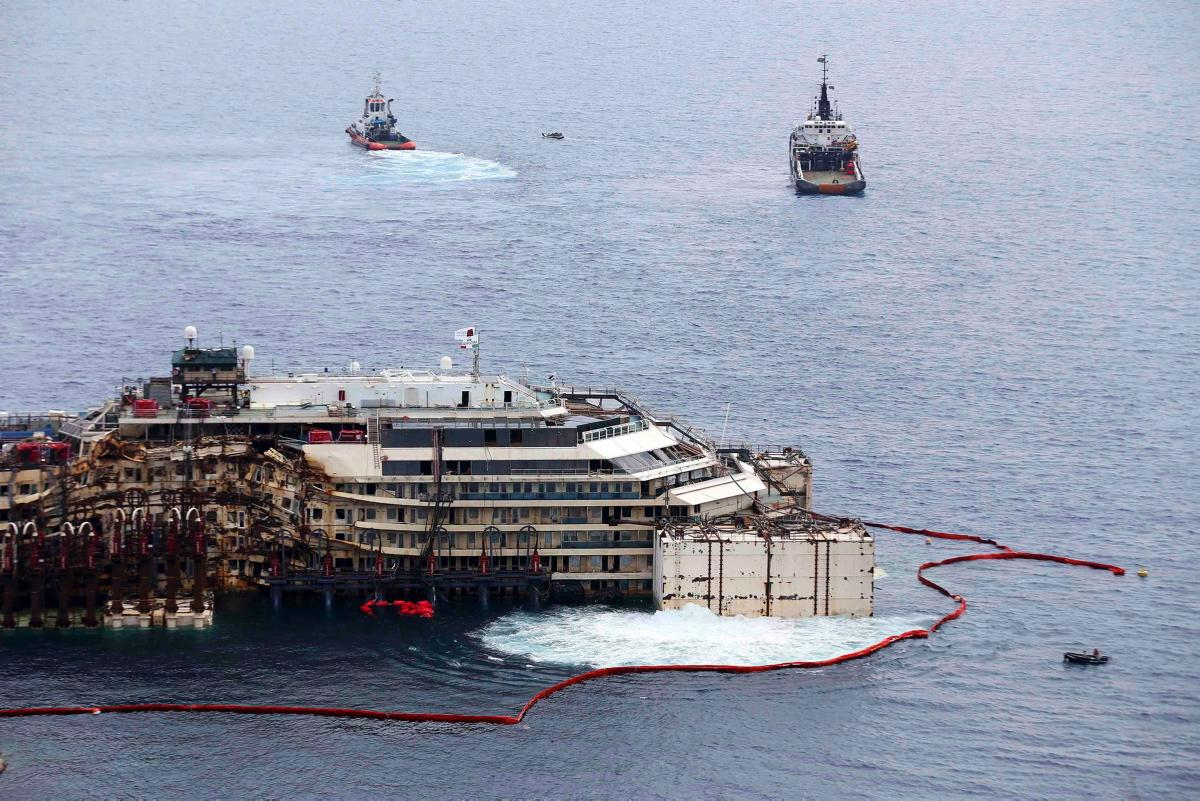 The now-parbuckled COSTA CONCORDIA venting ballast from the 1 and 2 starboard tanks as she prepares to be refloated