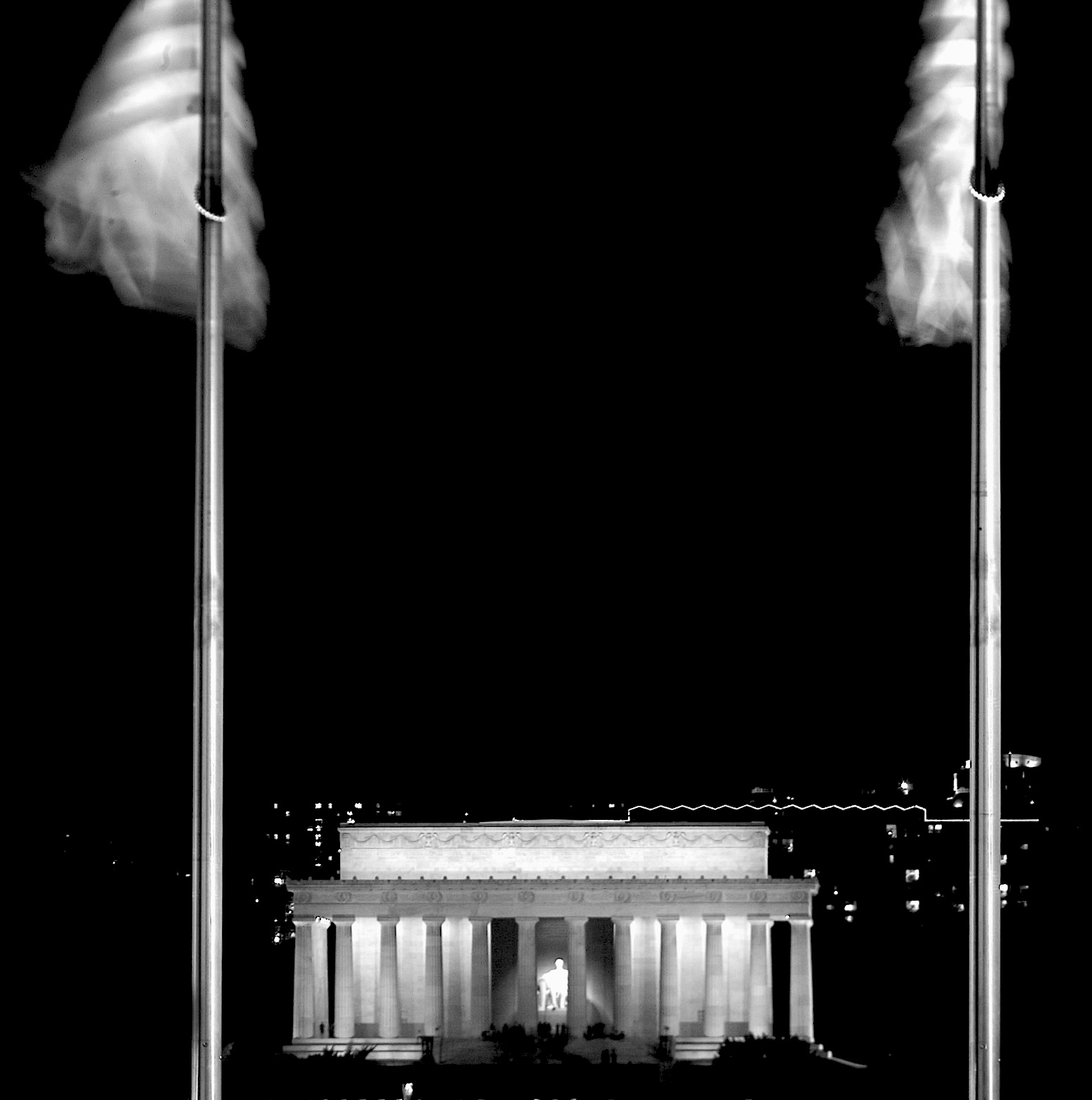 The Lincoln Memorial, as seen from the Washington Monument during a winter night. - Alex Lorman