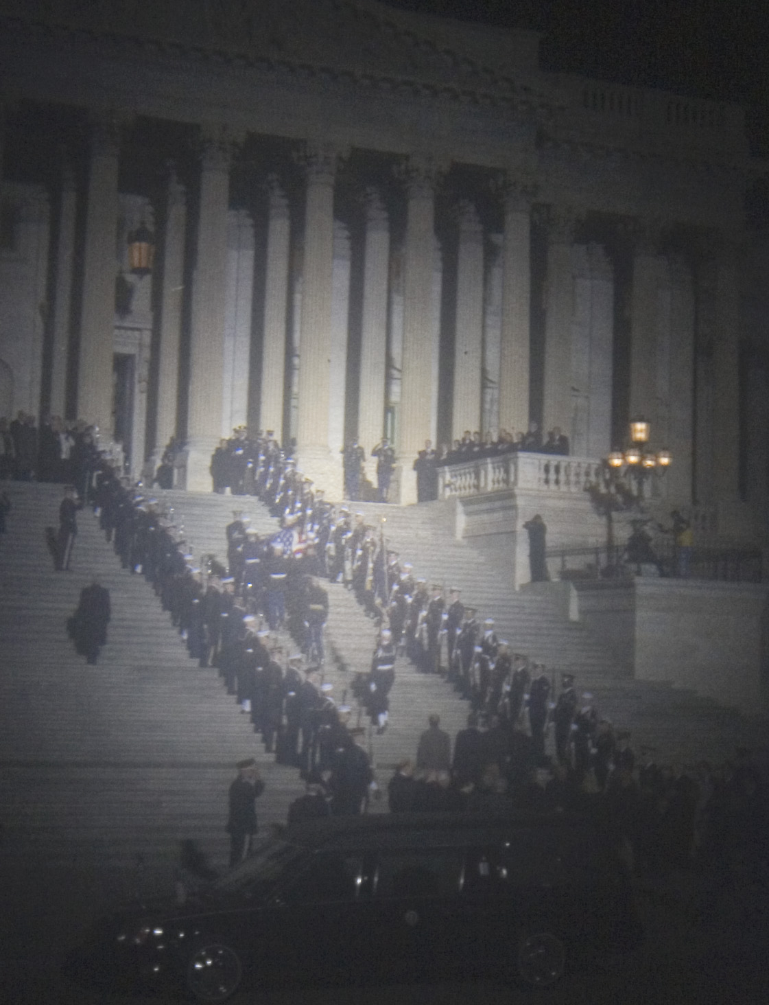The casket of President Ford is carried up the steps of the US Capital by a military honor guard prior to his lying in state in the Rotunda. - Alex Lorman