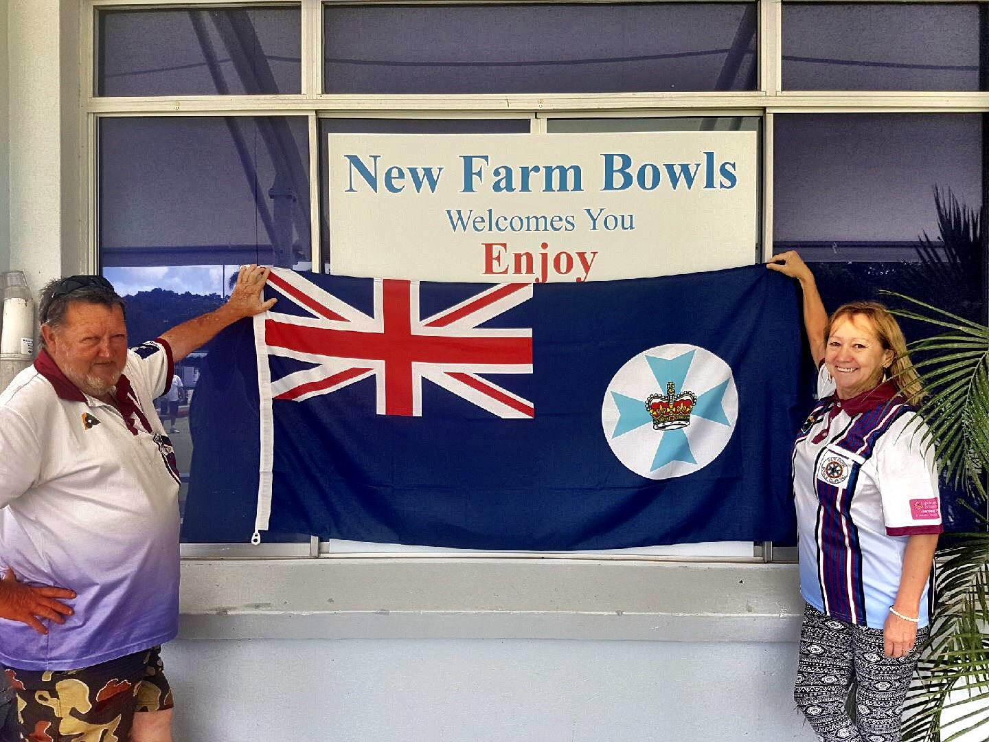 Roy and Lesley checking out  new farm bowls club's  new queensland flag. I was proud to deliver this to them.