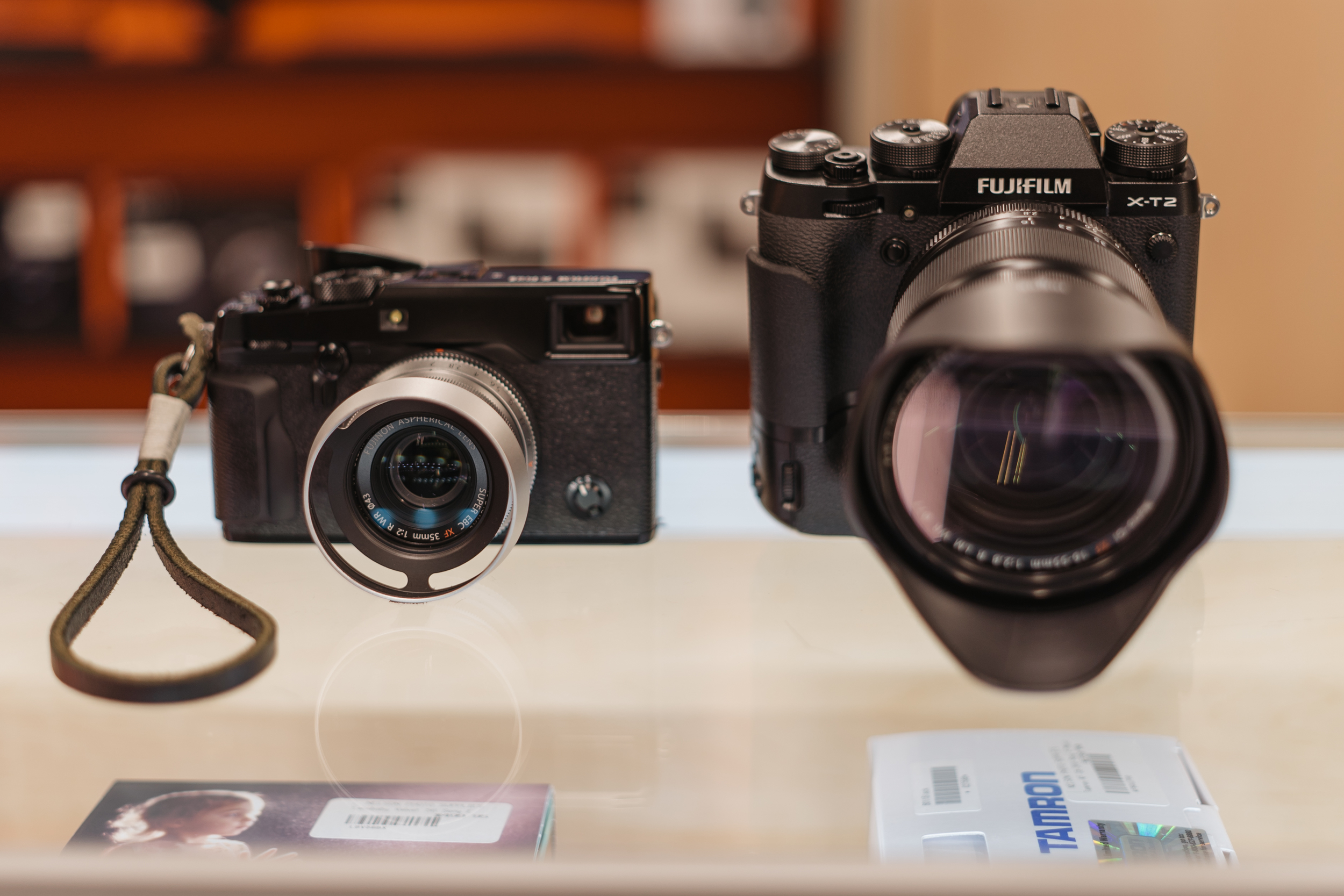 Left: XPro-2 Right: XT-2 with optional battery grip