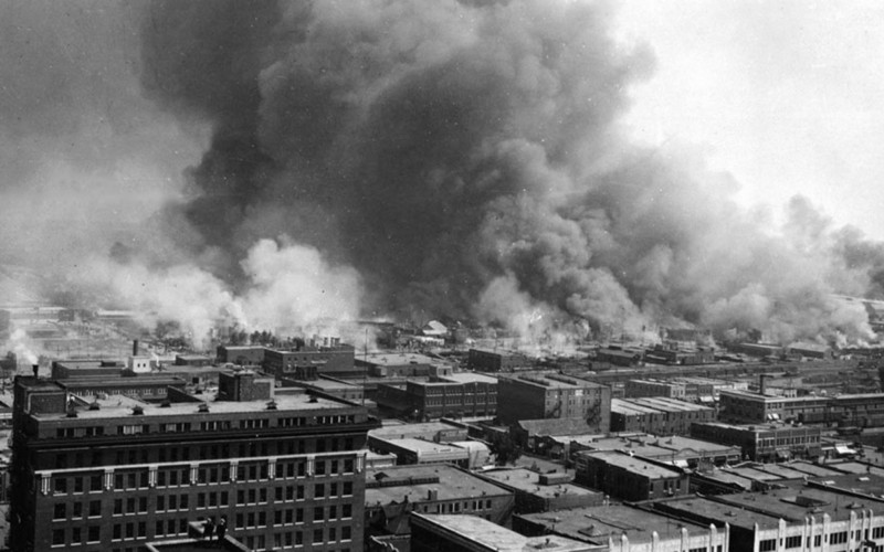 Smoke rising from the burning of Black Wall Street