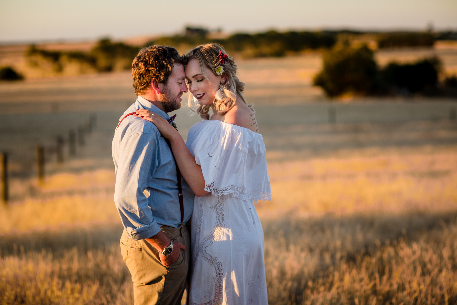 Bride and groom having their sunset portraits in an open field in Geelong.