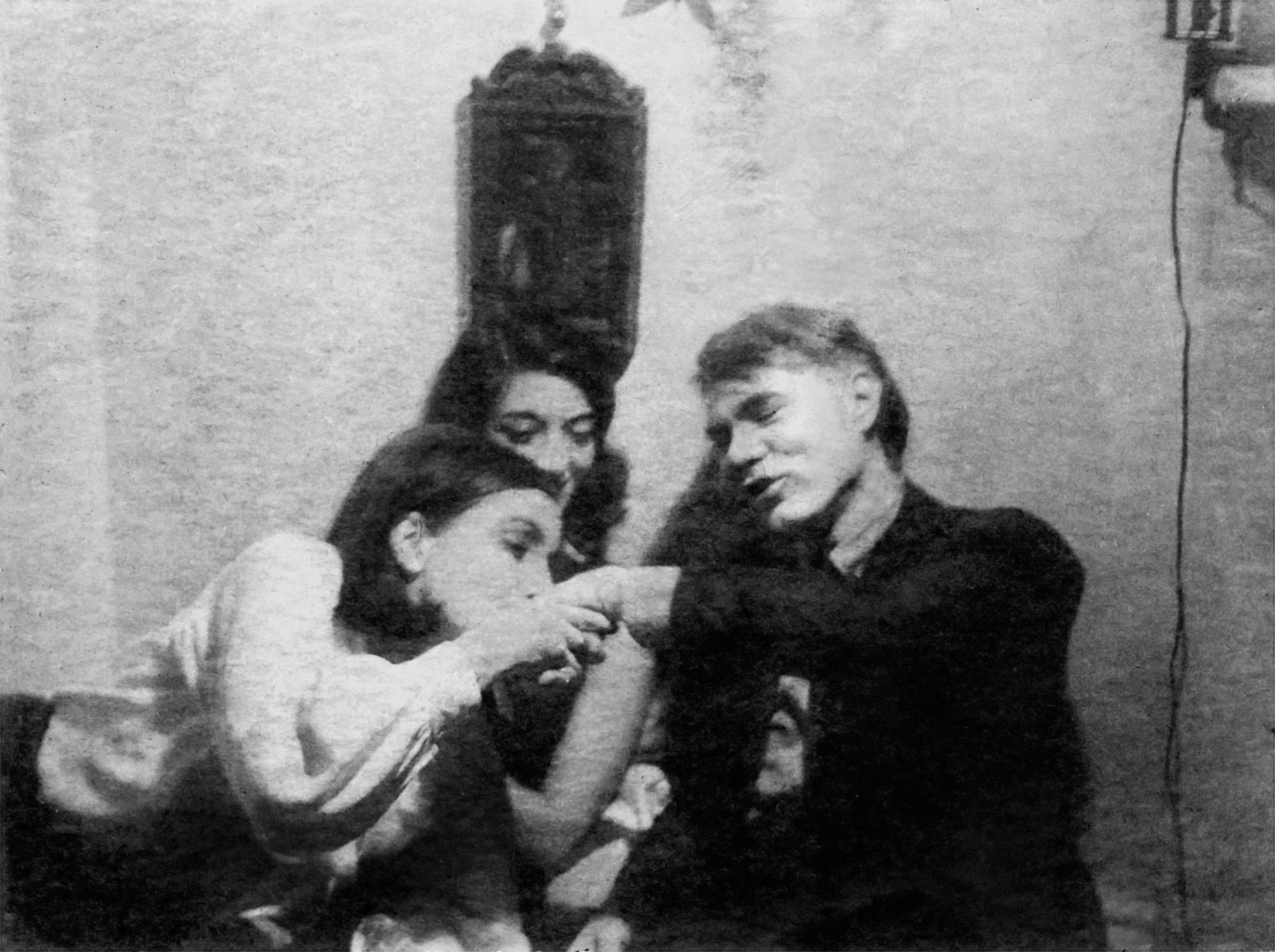 Bea kissing Andy Warhol's hand.
