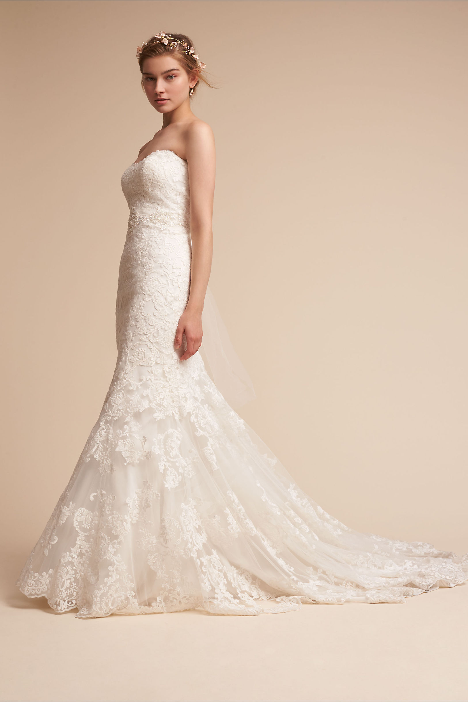 Marjorie Gown - BHLDN really does a great job. This pretty dress with floral lace applique is fitted through the hips and has a plunging back, with a stunning train.Price: $1600