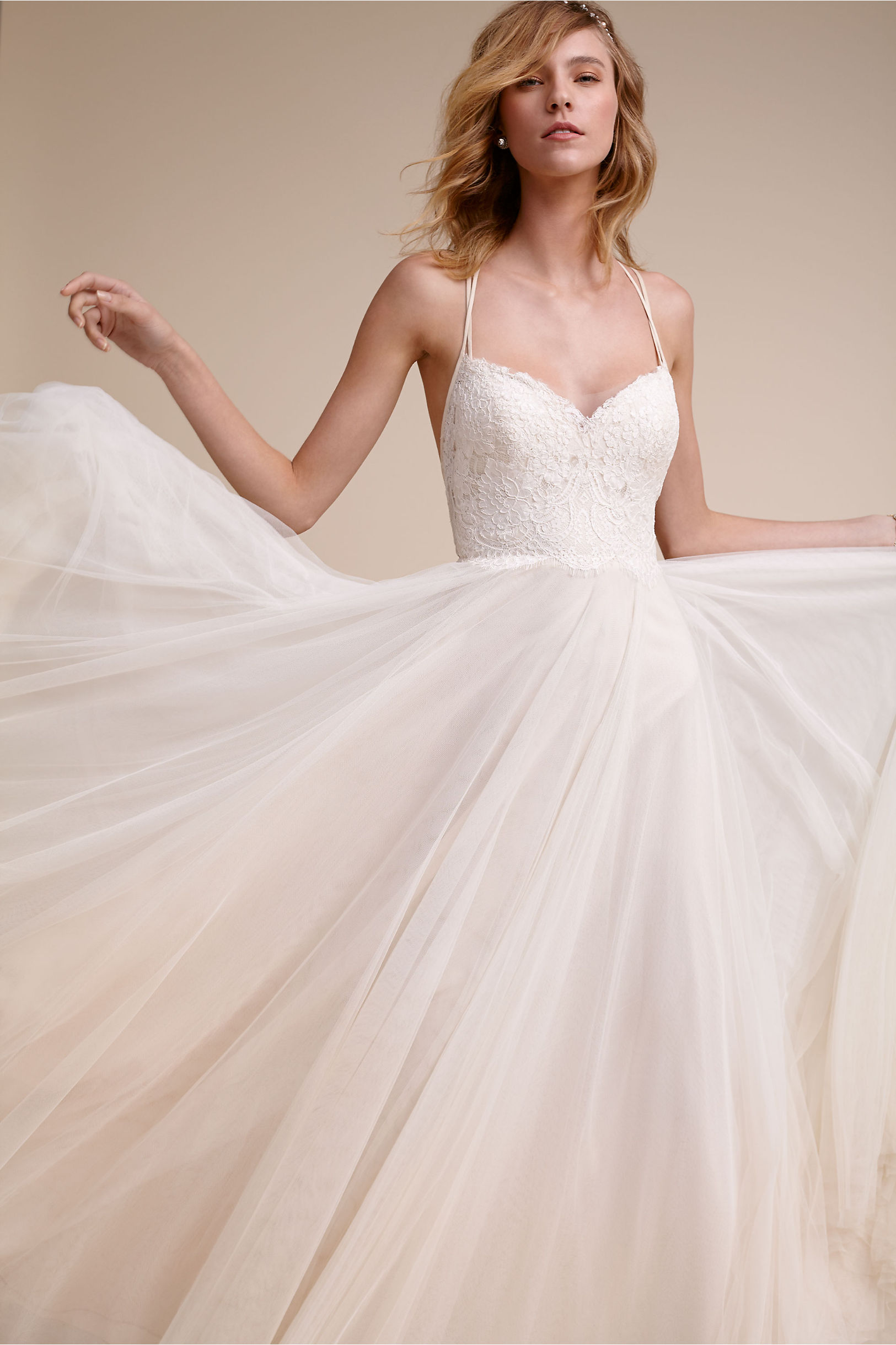 Rosalind Gown - Sorry not sorry, this beaut is also from BHLDN. Dainty straps create a beautiful back detail and a full tulle skirt give this gown so much movement and charm.Price: $1150
