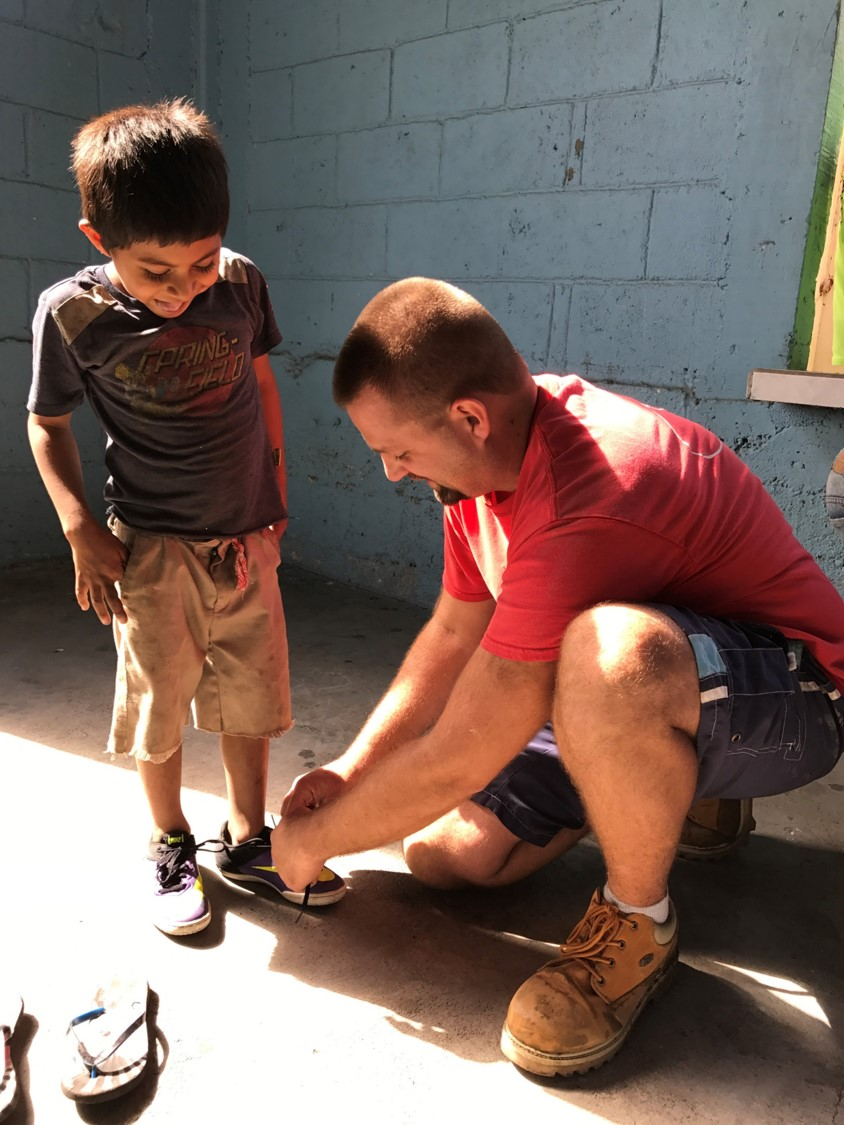 A pair of shoes given to a boy with a smile.