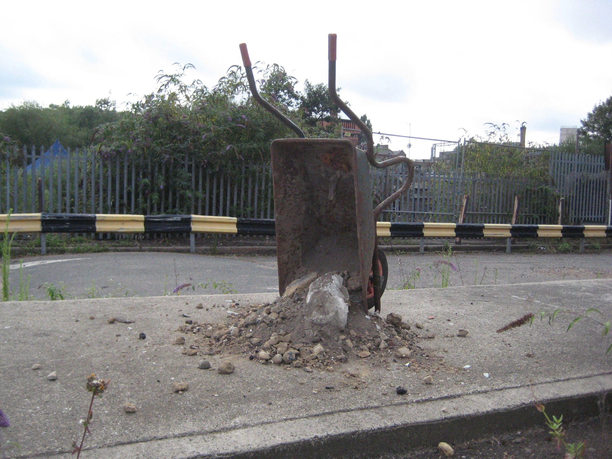 LXXXIII Wheelbarrow and site contents (tipped and stood).jpg