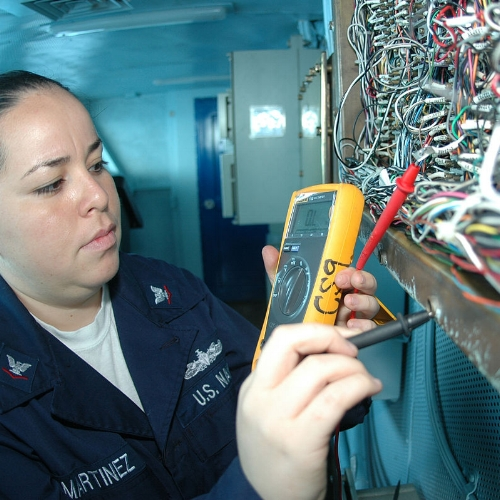 The military is an excellent place for an electrician: Electrician 3rd Class Karla Martinez inspects wiring aboard the aircraft carrier USS Nimitz
