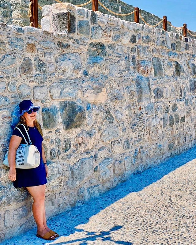 "I'm successfully holding up this wall, acting as ""sweeper"" to keep@the group together, and hiding from the sun. Multitasking at its best! :)) #Takethewin #greekislands #thesunisnotmyfriend #adventuretravel #offthebeatenpath  #islandhopping"