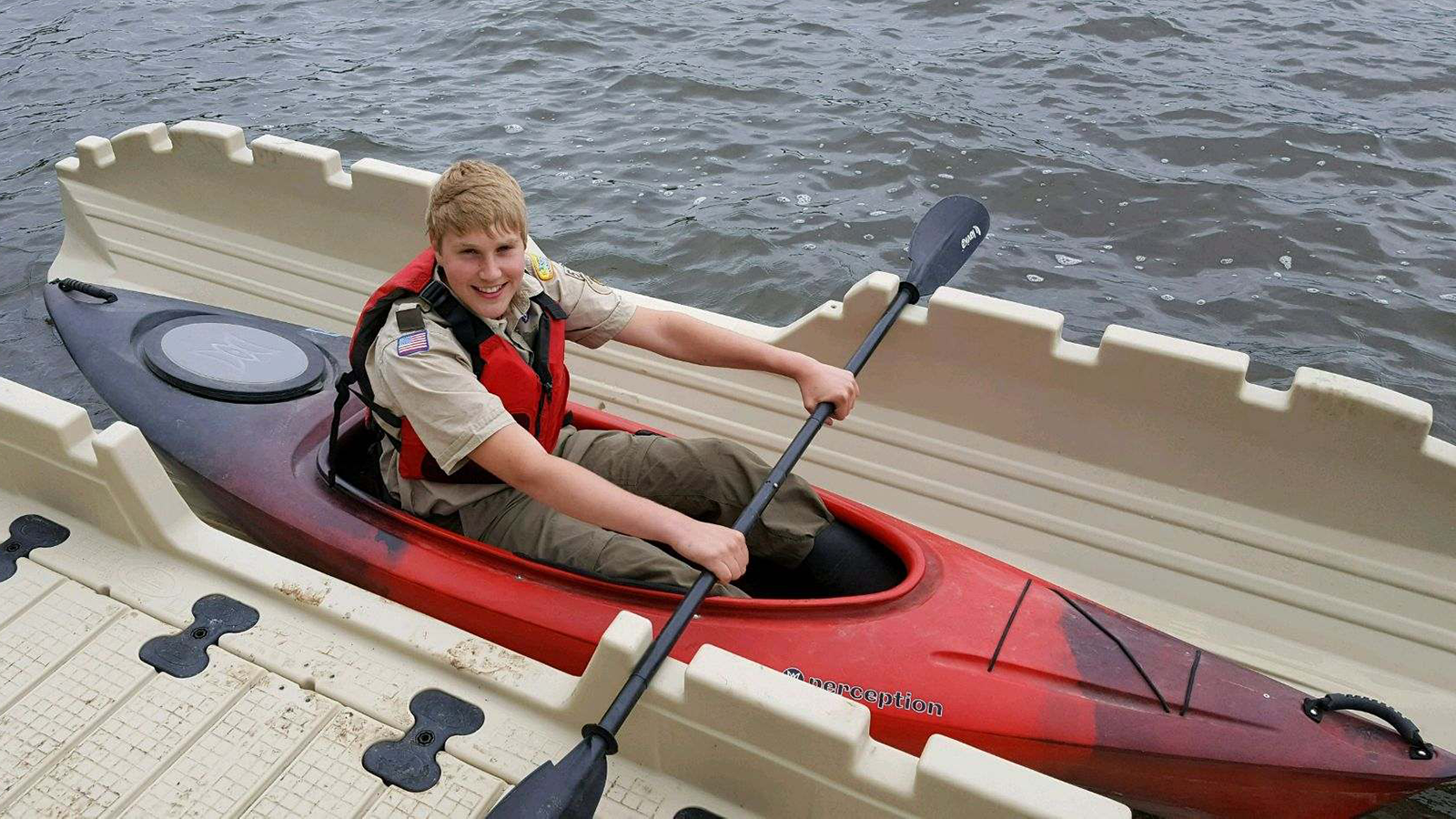 Connor Madsen demonstrates the kayak launch he organized as his Eagle Scout project.