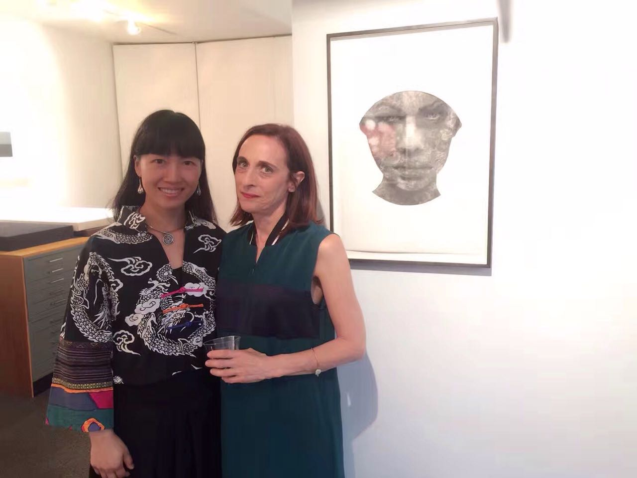Opening Night Sept. 14, 2017 : Shanlin Ye and Director Dru Arstark with Shanlin's Reflection Series. Watercolor on Paper. Produced in 2017