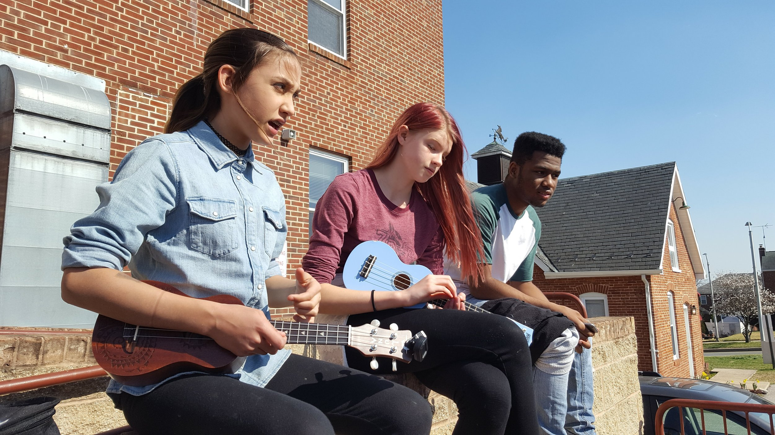 Ukeleles are strummed at A&I Sudbury School in Baltimore.