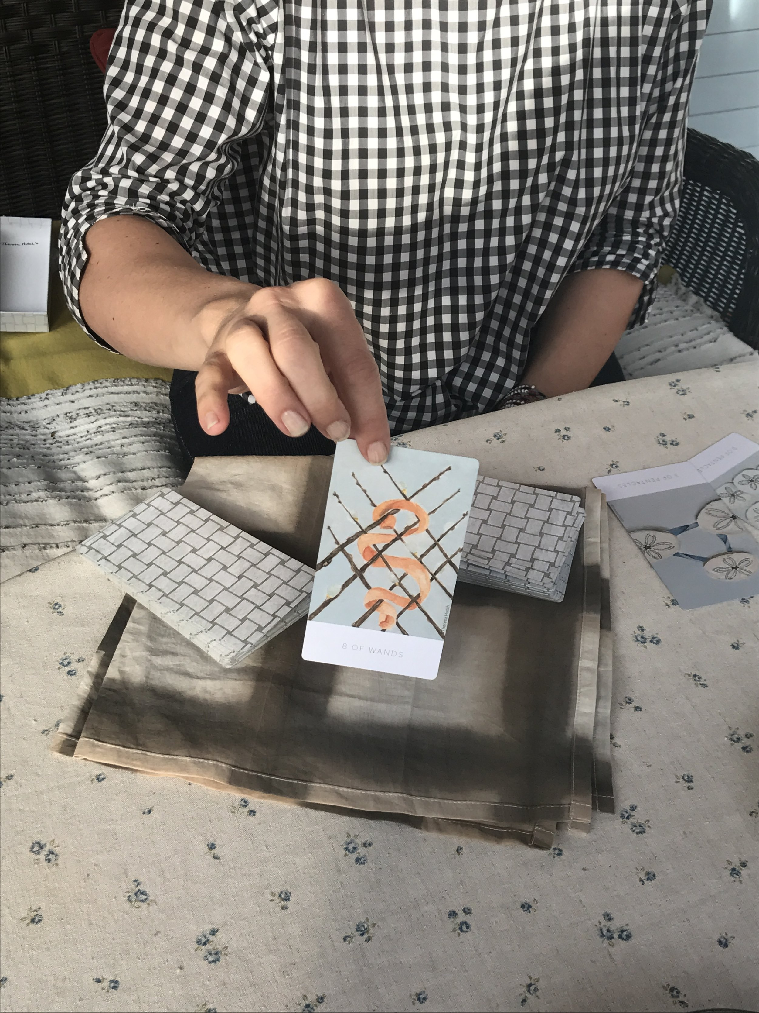 We pulled a card, the 8 of Wands, from her personal edition of the White Sage Tarot Deck. The artist associates Wands with Svadhishthana, the creativity chakra, and this specific card symbolizes change and travel.