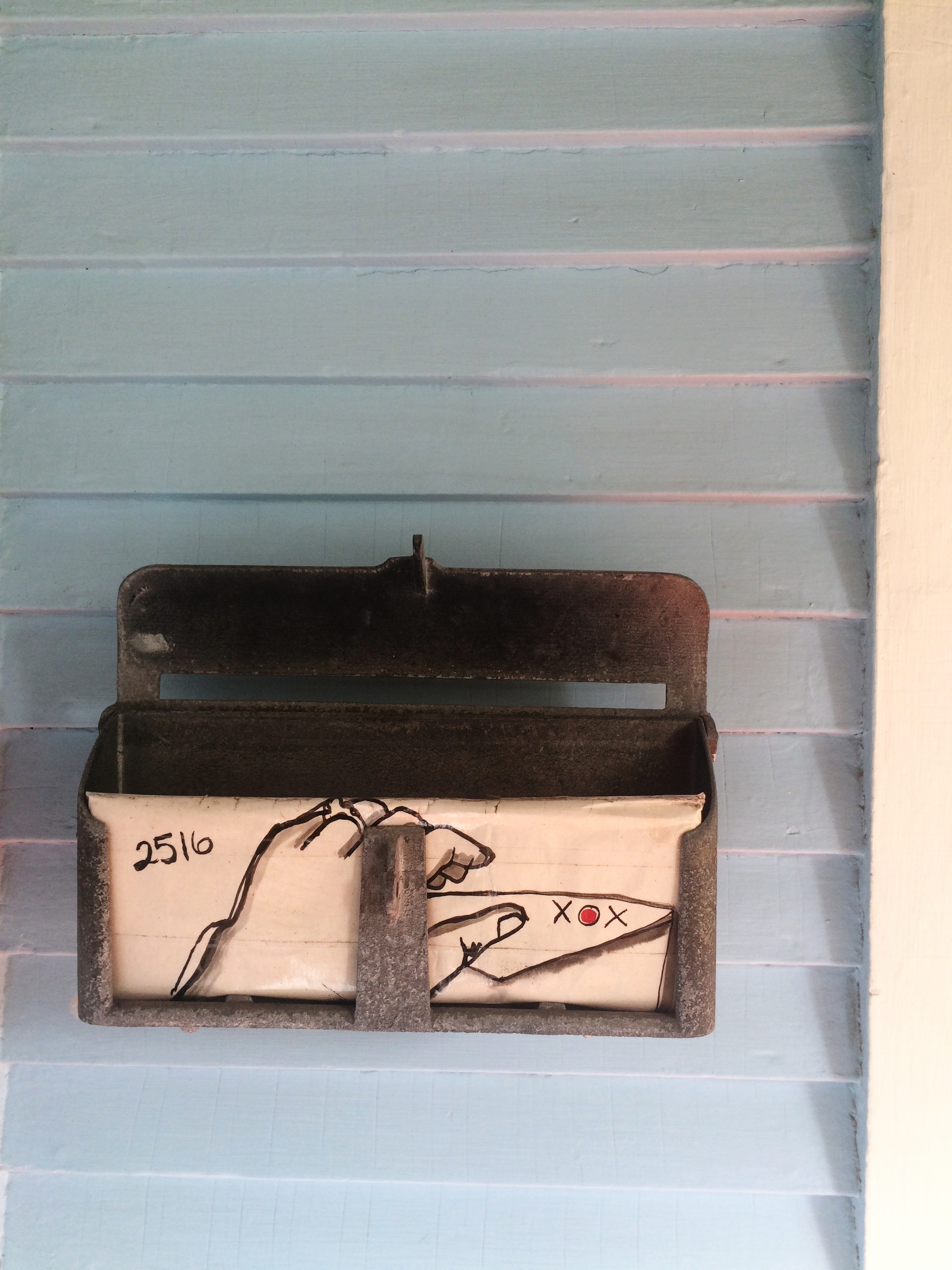 A hand painted mailbox encourages love letters instead of bills.
