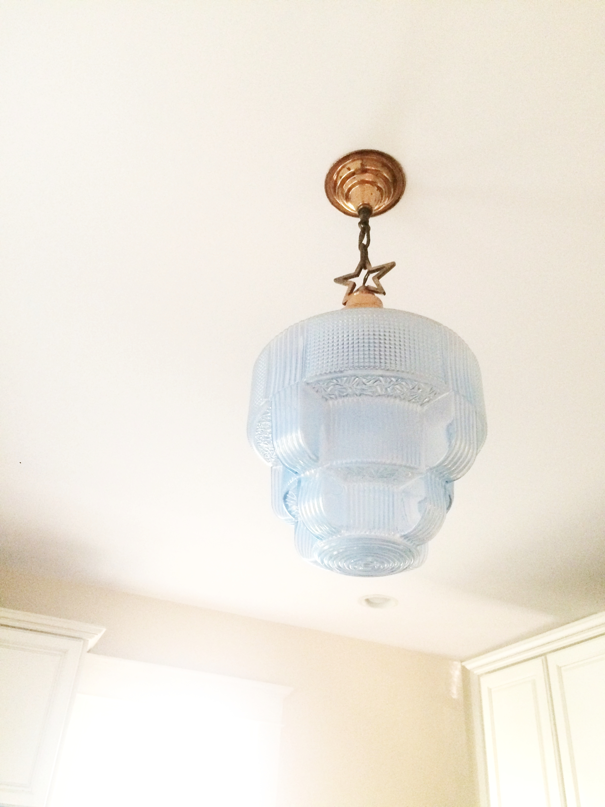 This vintage store lamp was one of Theresa's first major home purchases. It's traveled with her to each new home since her 20s.