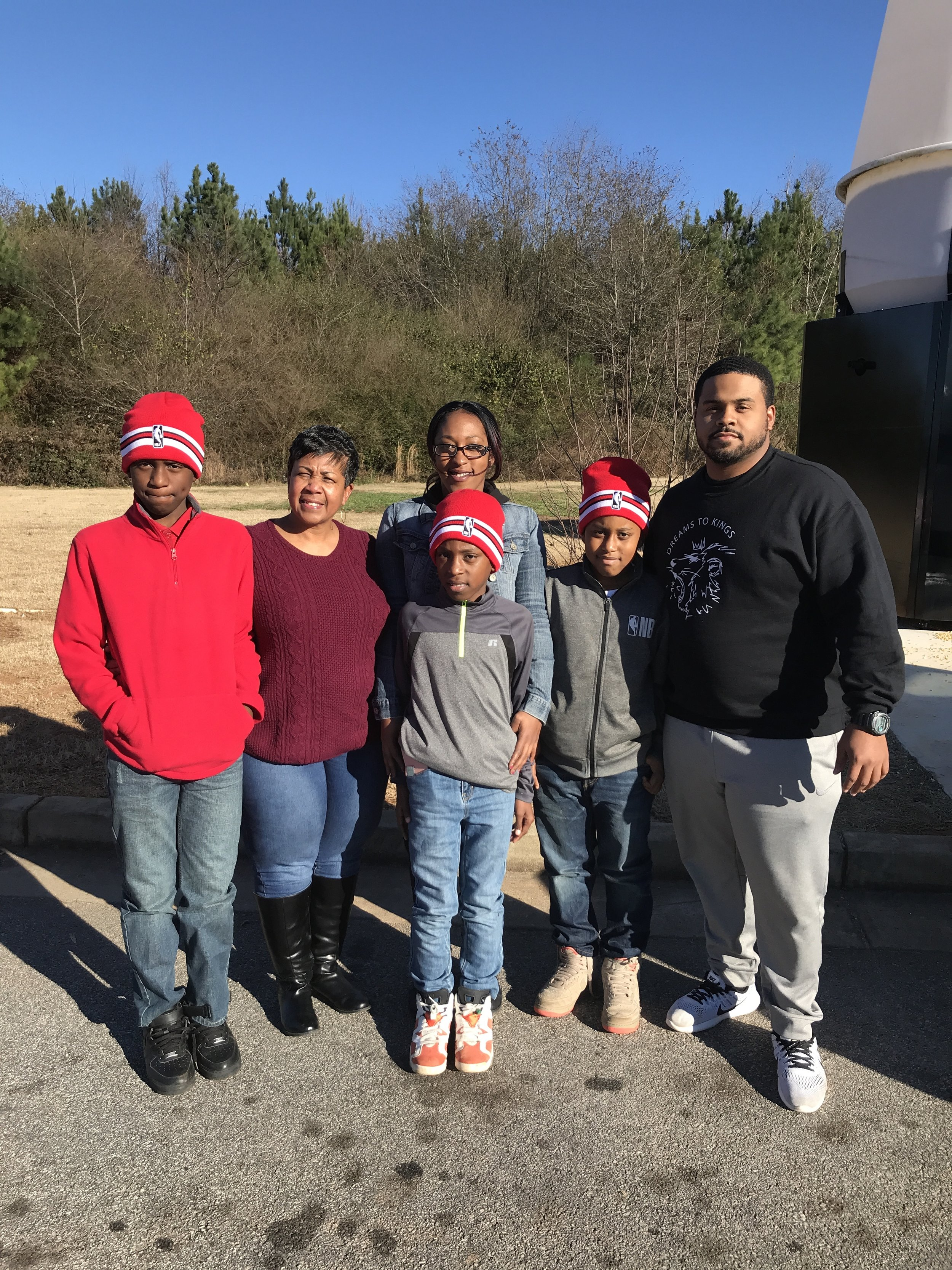 CEO & Founder, Tracy Stephens with the family we were able to help out this holiday season. We want to thank everyone that donated towards our Holiday Blessings initiative.