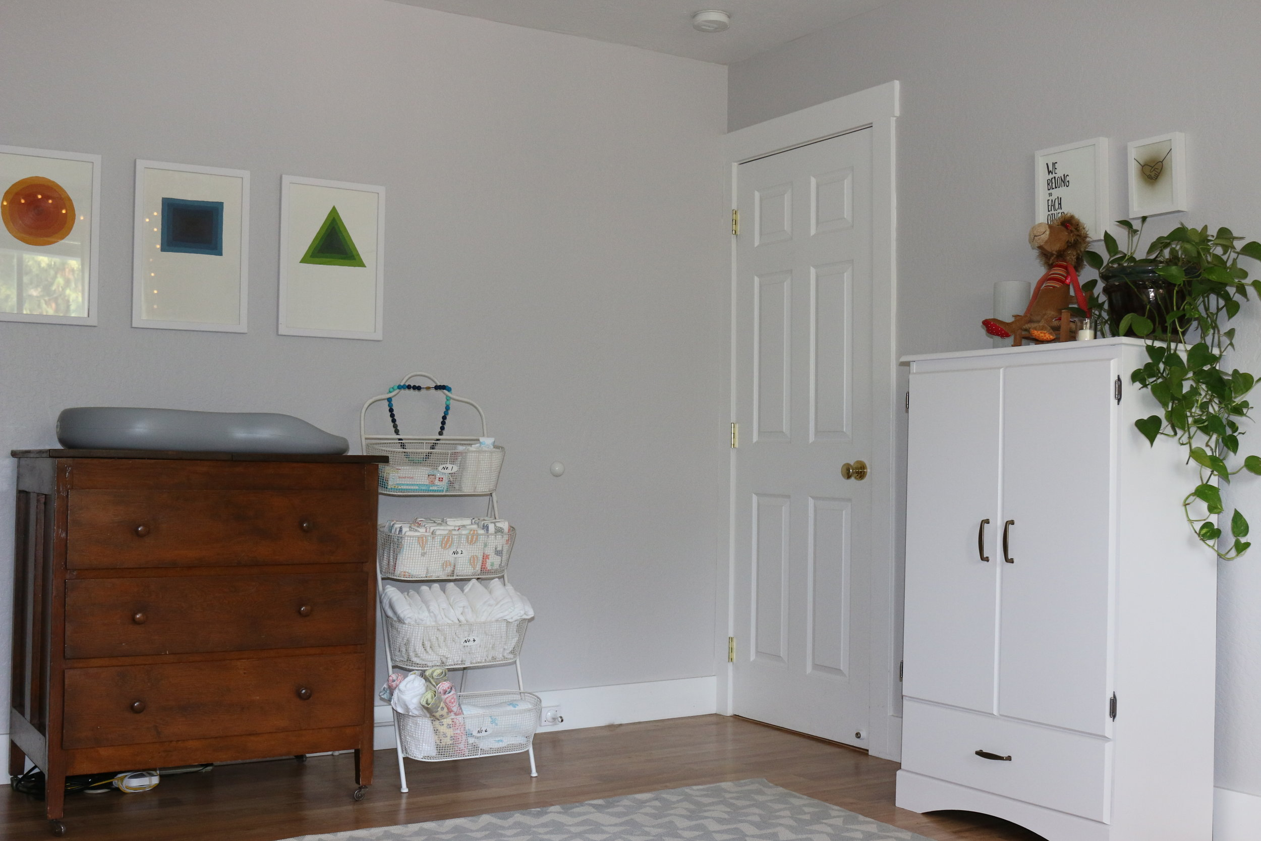 The white armoire is from a garage sale and was repainted, the art above the armoire is from www.jaybryantjones.com who happens to be Daddy.