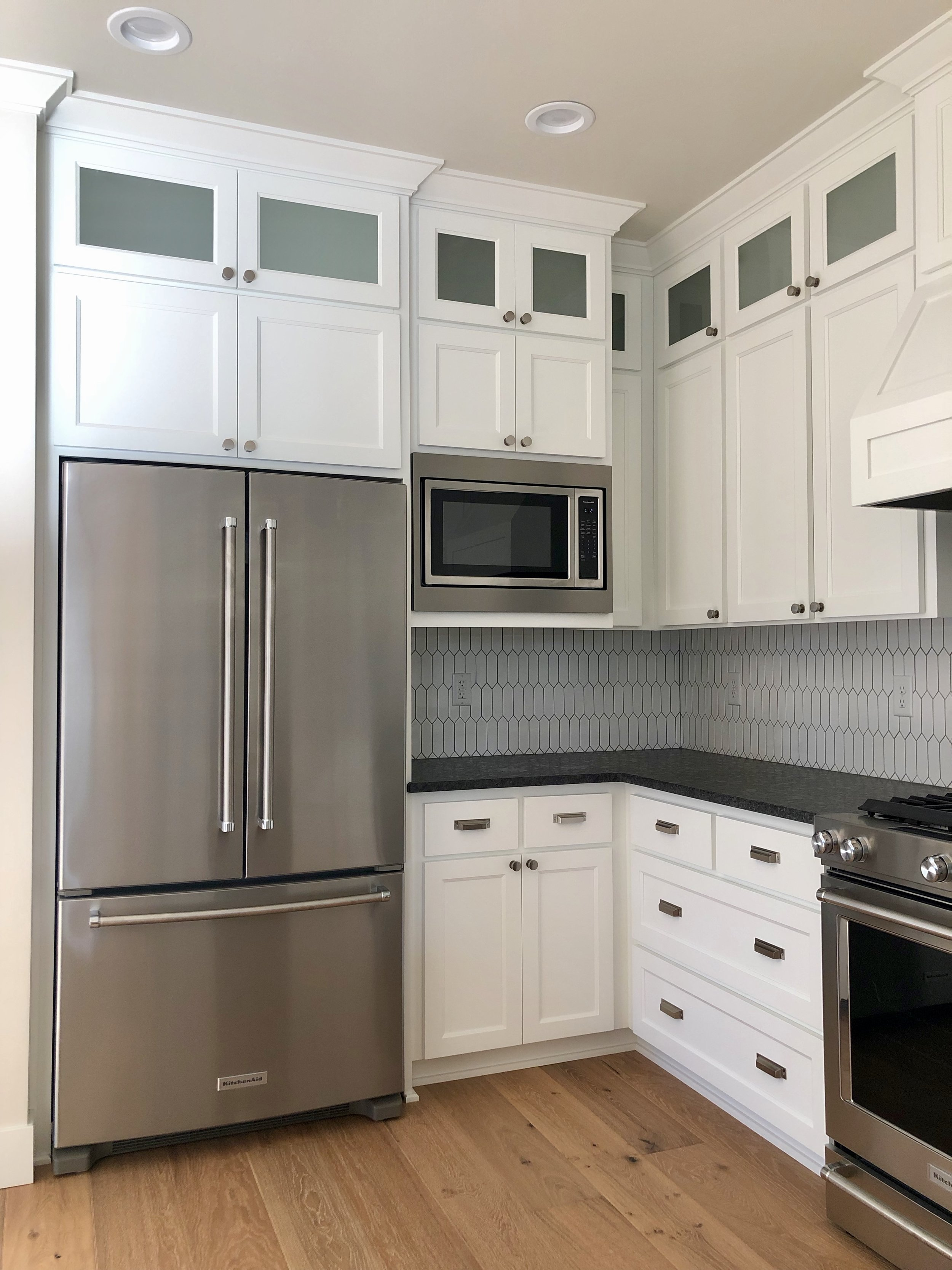The kitchen is spacious and has a lot of storage. We love the layout and also how from the kitchen you can see out of all the windows, taking in the beautiful Ashland views.
