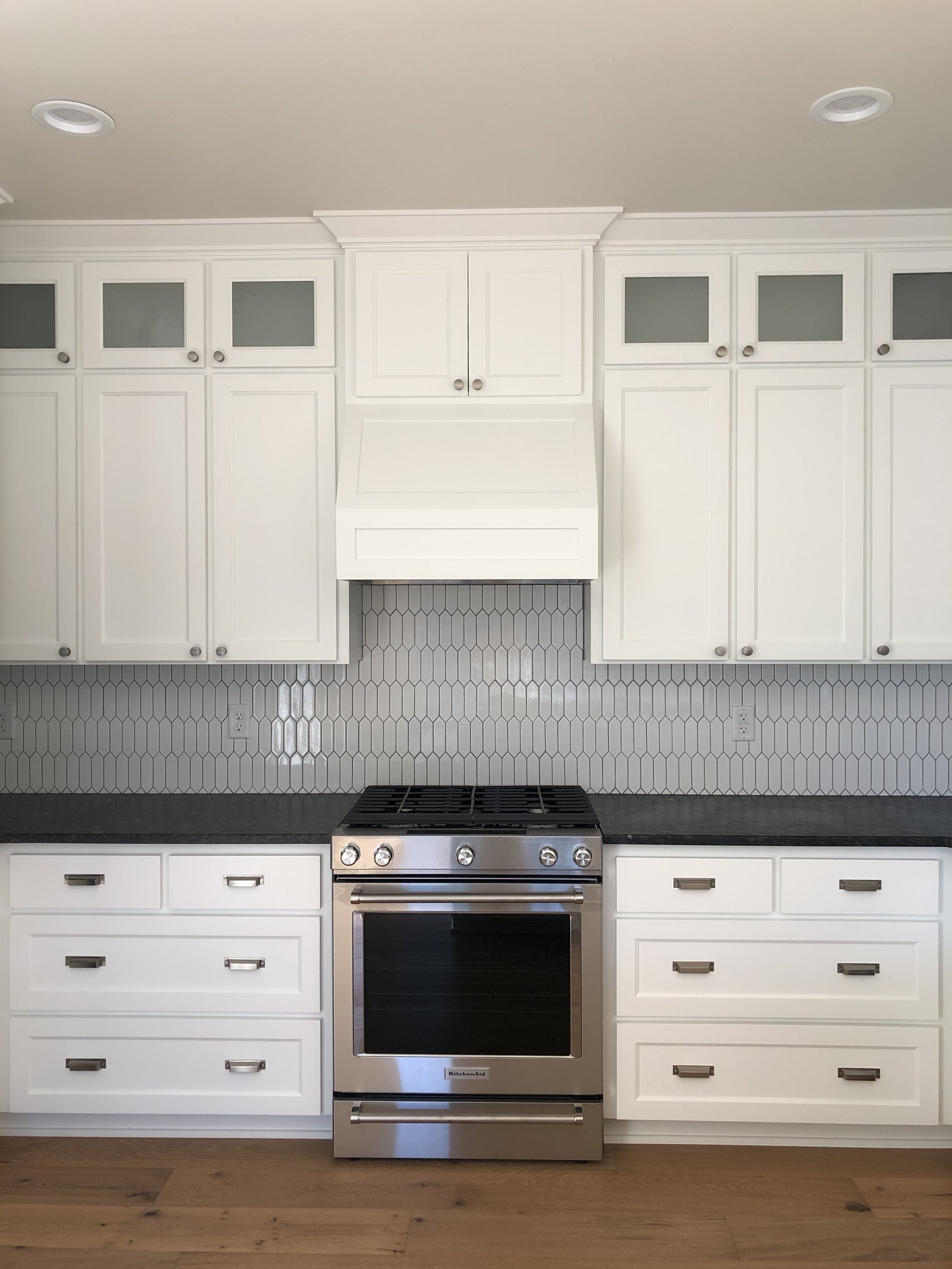 The kitchen cabinets extend all the way to the ceiling with additional storage.