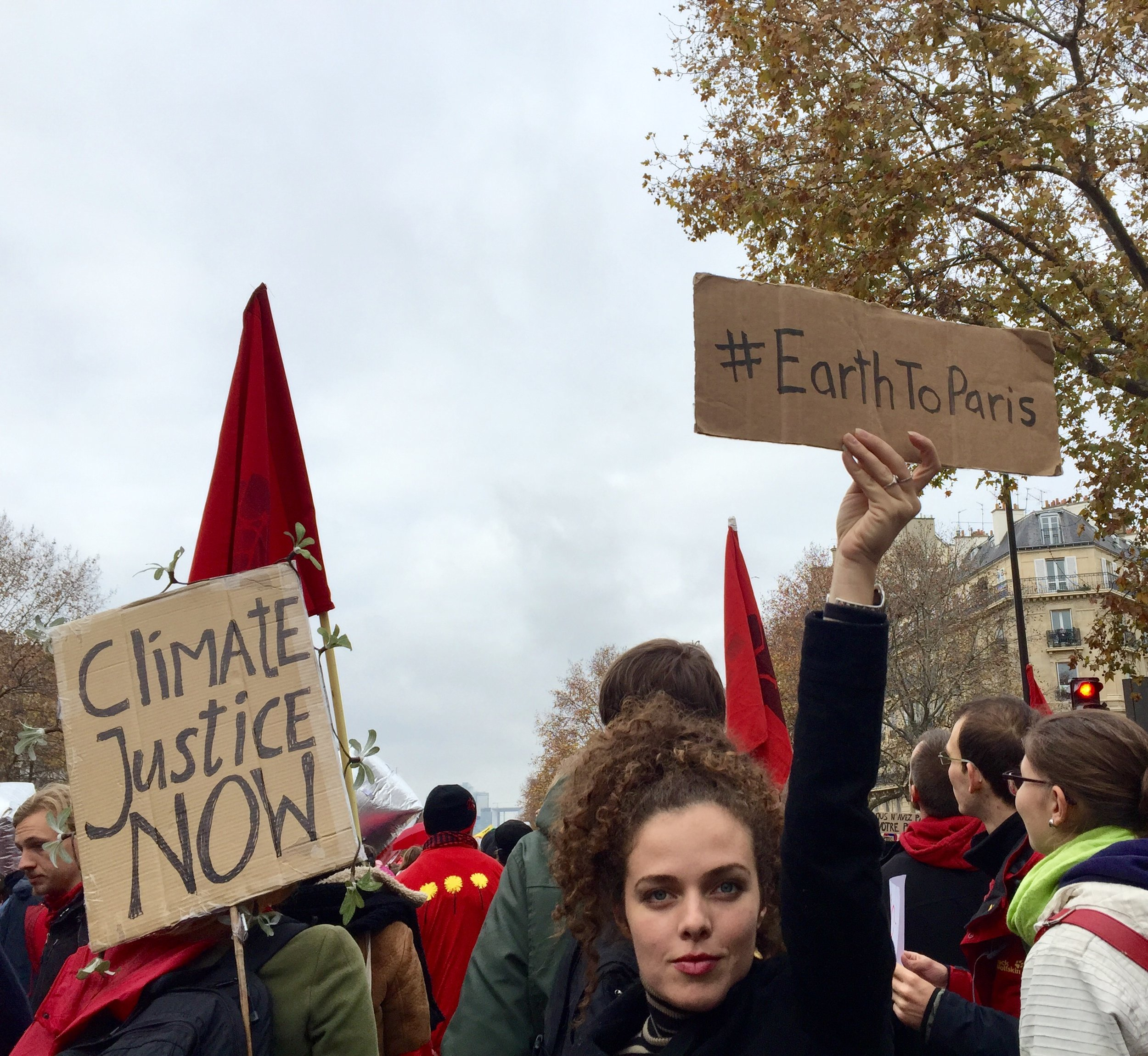 Climate marching in Paris after working on the Earth To Paris campaign for the United Nation's Framework Convention on Climate Change / COP21 Paris Agreement.