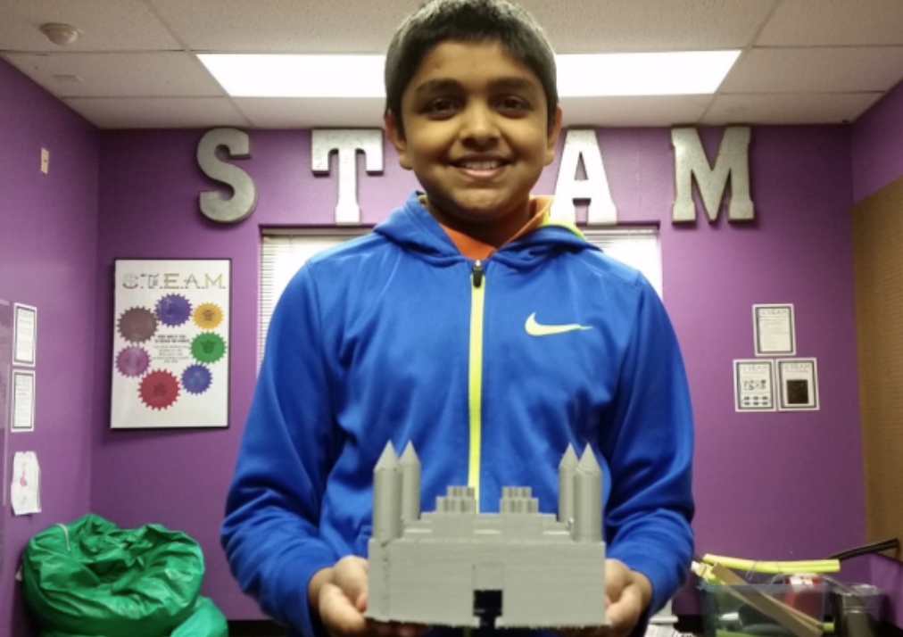 The GenYES student with his 3d-printed design.