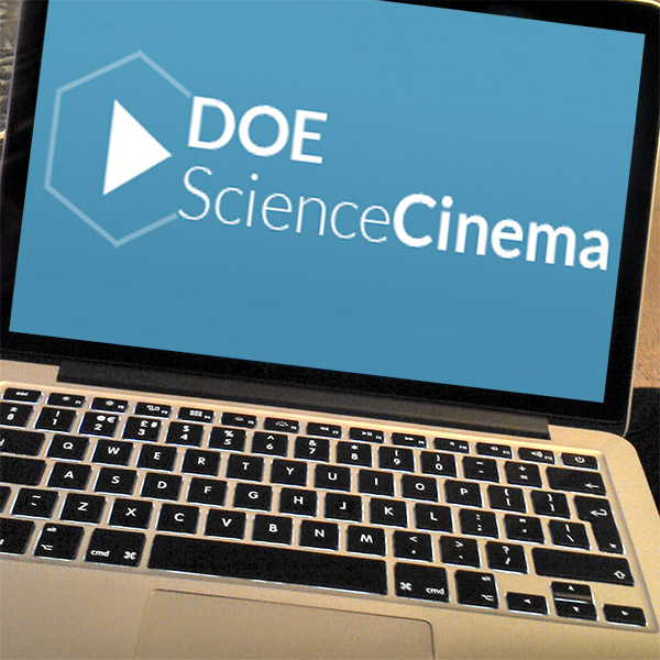 A laptop screen displaying the Department of Energy Science Cinema logo against a blue background. Image by whatleydude. Modified by L. Rochester 2/27/2019. Description: